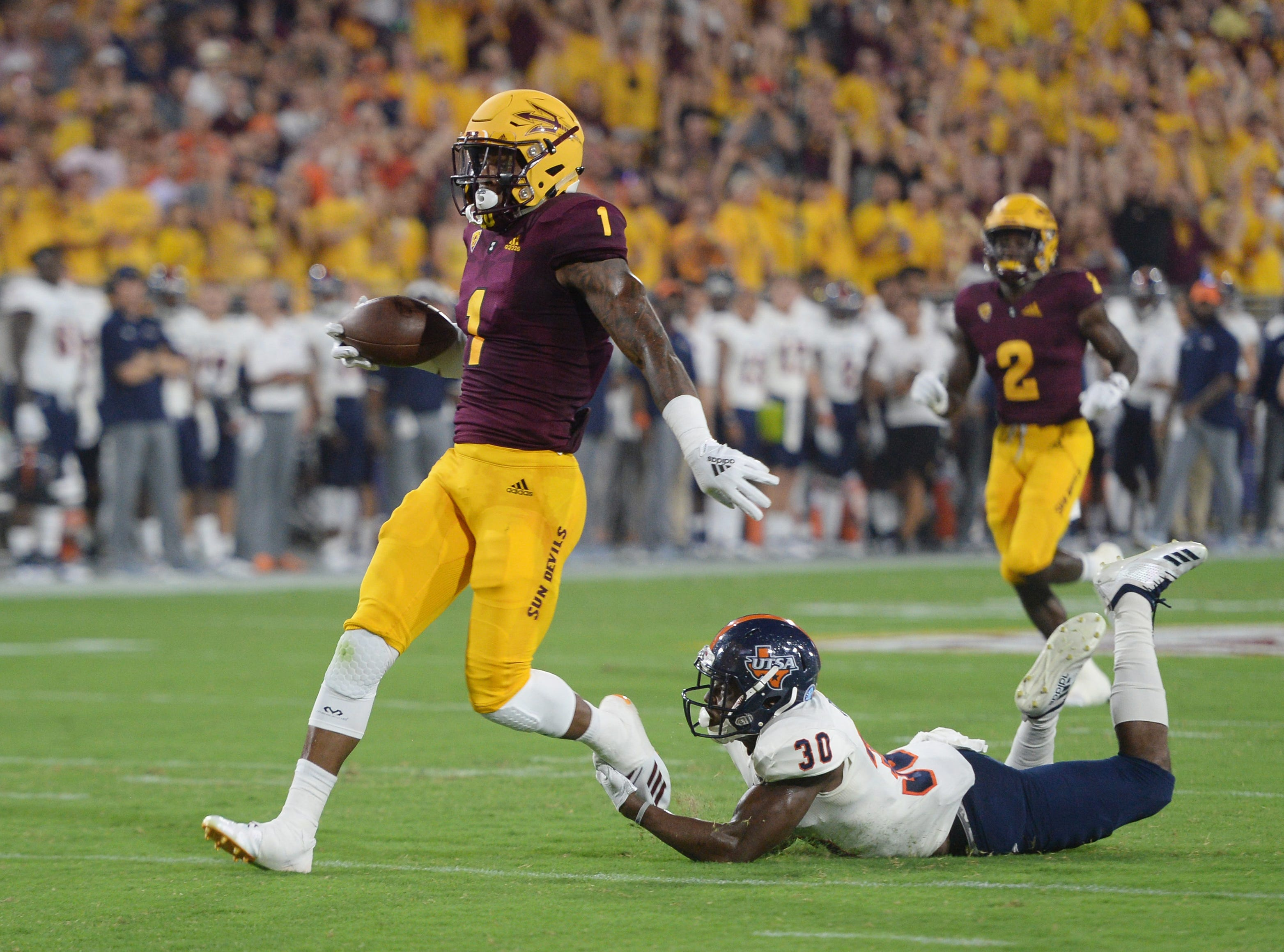 Sep 1, 2018; Tempe, AZ, USA; Arizona State Sun Devils wide receiver N'Keal Harry (1) runs past UTSA Roadrunners cornerback Stanley Dye Jr. (30) en route to a touchdown during the first half at Sun Devil Stadium.