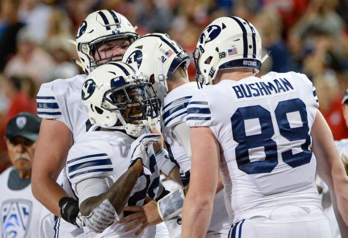 Sep 1, 2018; Tucson, AZ, USA; Brigham Young Cougars running back Squally Canada (22) and tight end Matt Bushman (89) celebrate after a touchdown against the Arizona Wildcats during the second half at Arizona Stadium.
