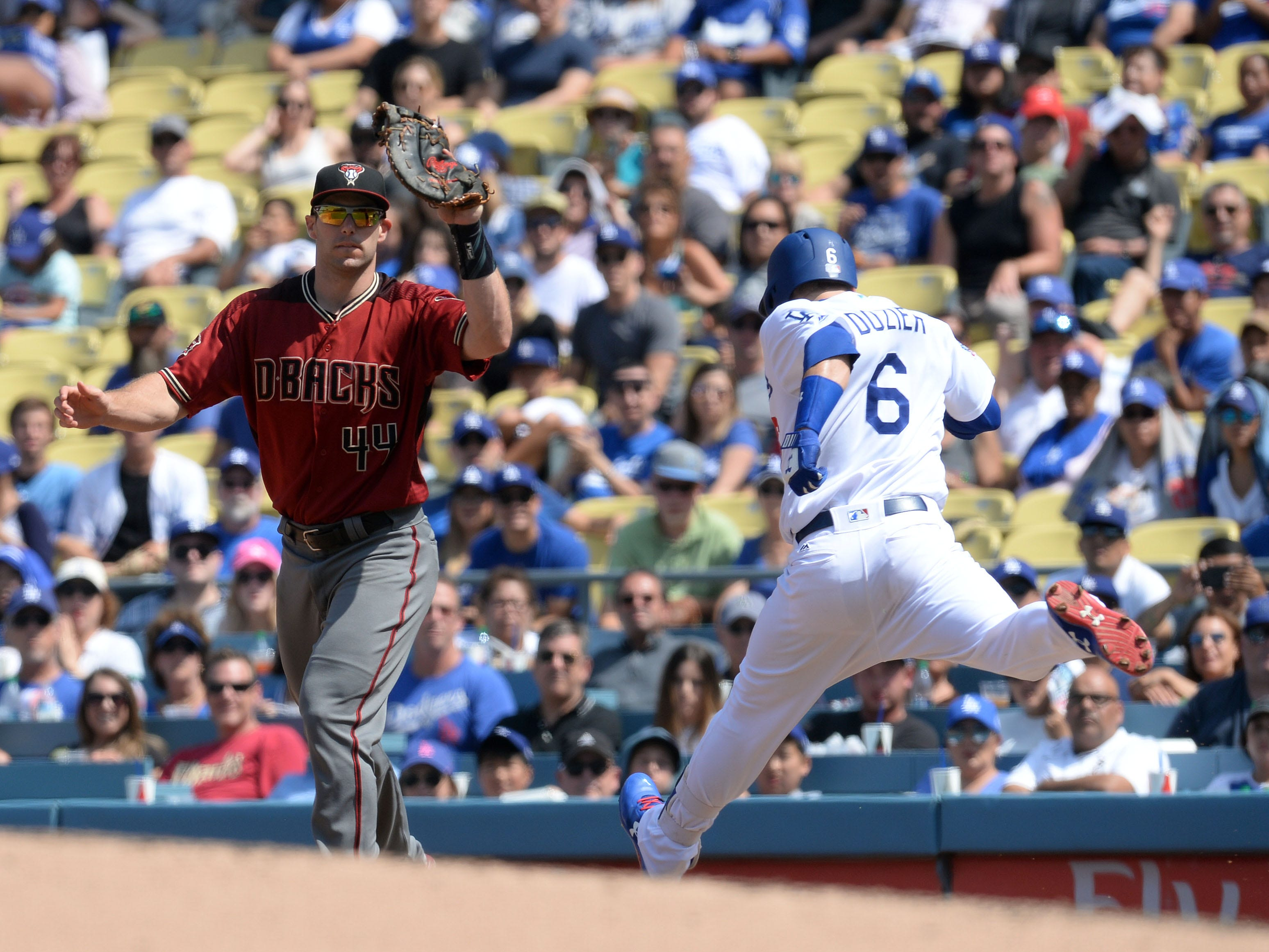 September 2, 2018; Los Angeles, CA, USA; Los Angeles Dodgers second baseman Brian Dozier (6) is out at first against Arizona Diamondbacks first baseman Paul Goldschmidt (44) in the fourth inning at Dodger Stadium. Mandatory Credit: Gary A. Vasquez-USA TODAY Sports