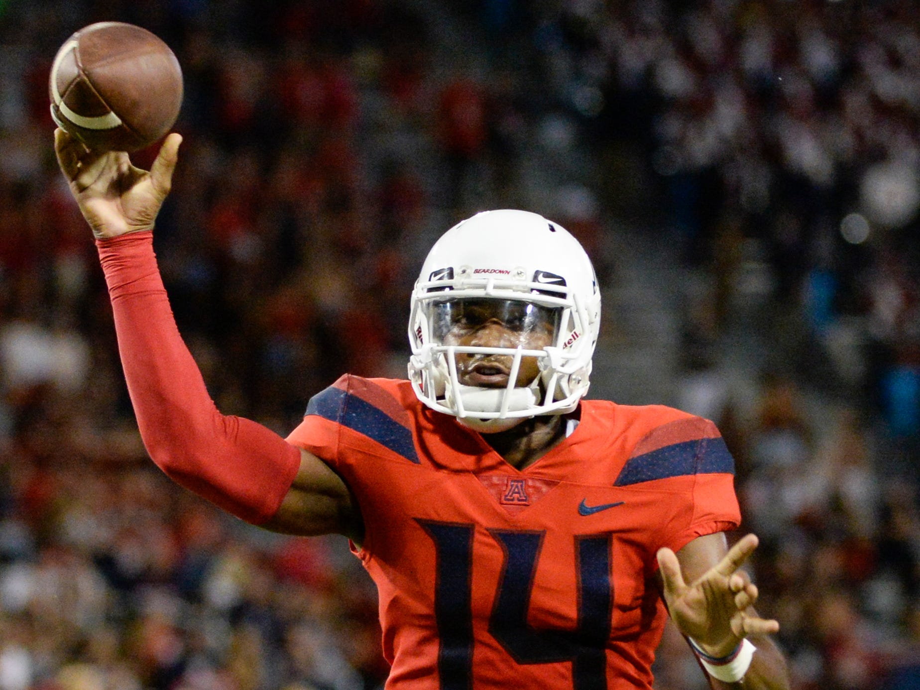 Sep 1, 2018; Tucson, AZ, USA; Arizona Wildcats quarterback Khalil Tate (14) passes the ball against the Brigham Young Cougars during the first half at Arizona Stadium.
