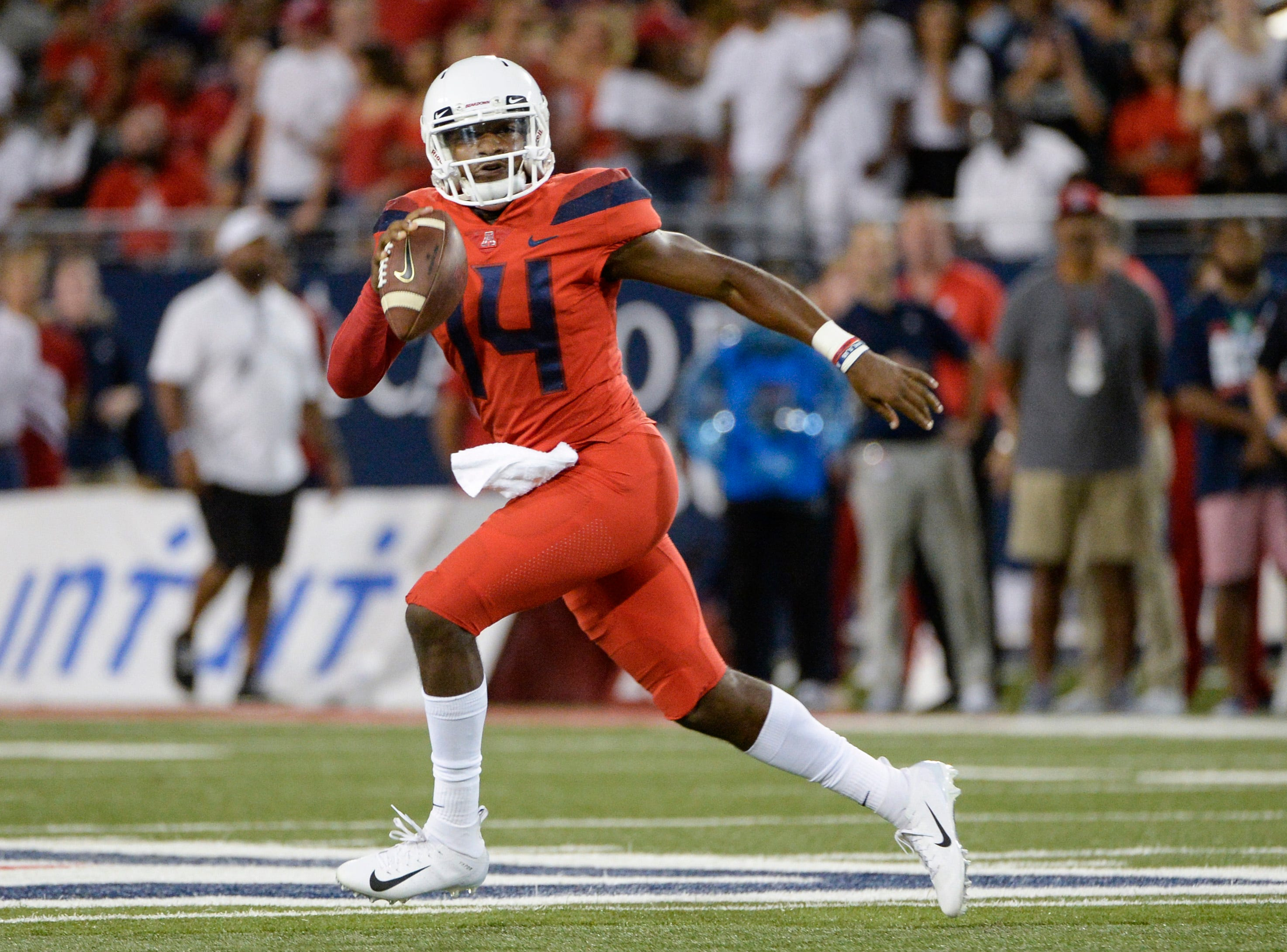 Sep 1, 2018; Tucson, AZ, USA; Arizona Wildcats quarterback Khalil Tate (14) runs the ball against the Brigham Young Cougars during the first quarter at Arizona Stadium.
