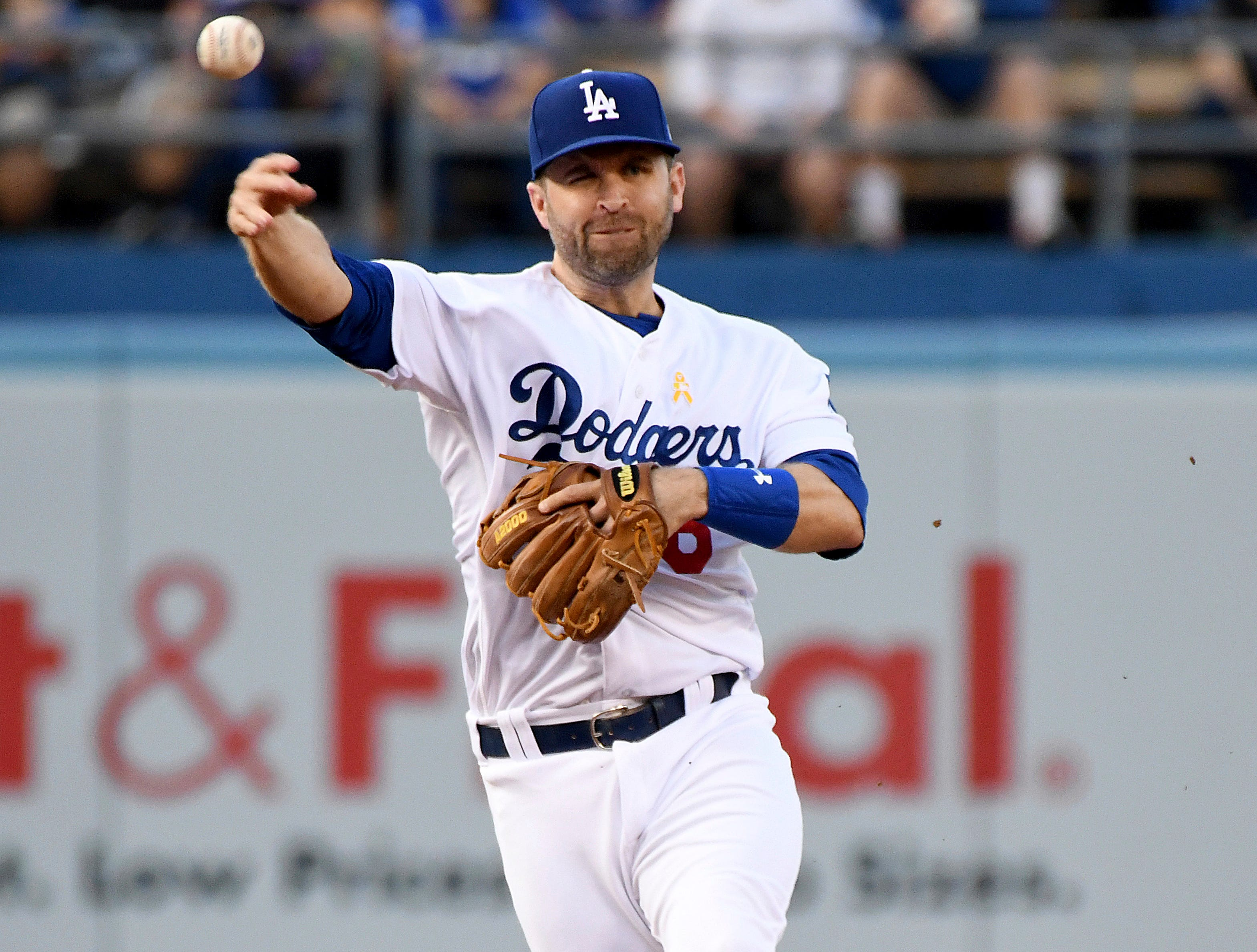 Los Angeles Dodgers second baseman Brian Dozier throws to first base after fielding a grounder by Arizona Diamondbacks' Paul Goldschmidt during the first inning of a baseball game, Saturday, Sept. 1, 2018, in Los Angeles.