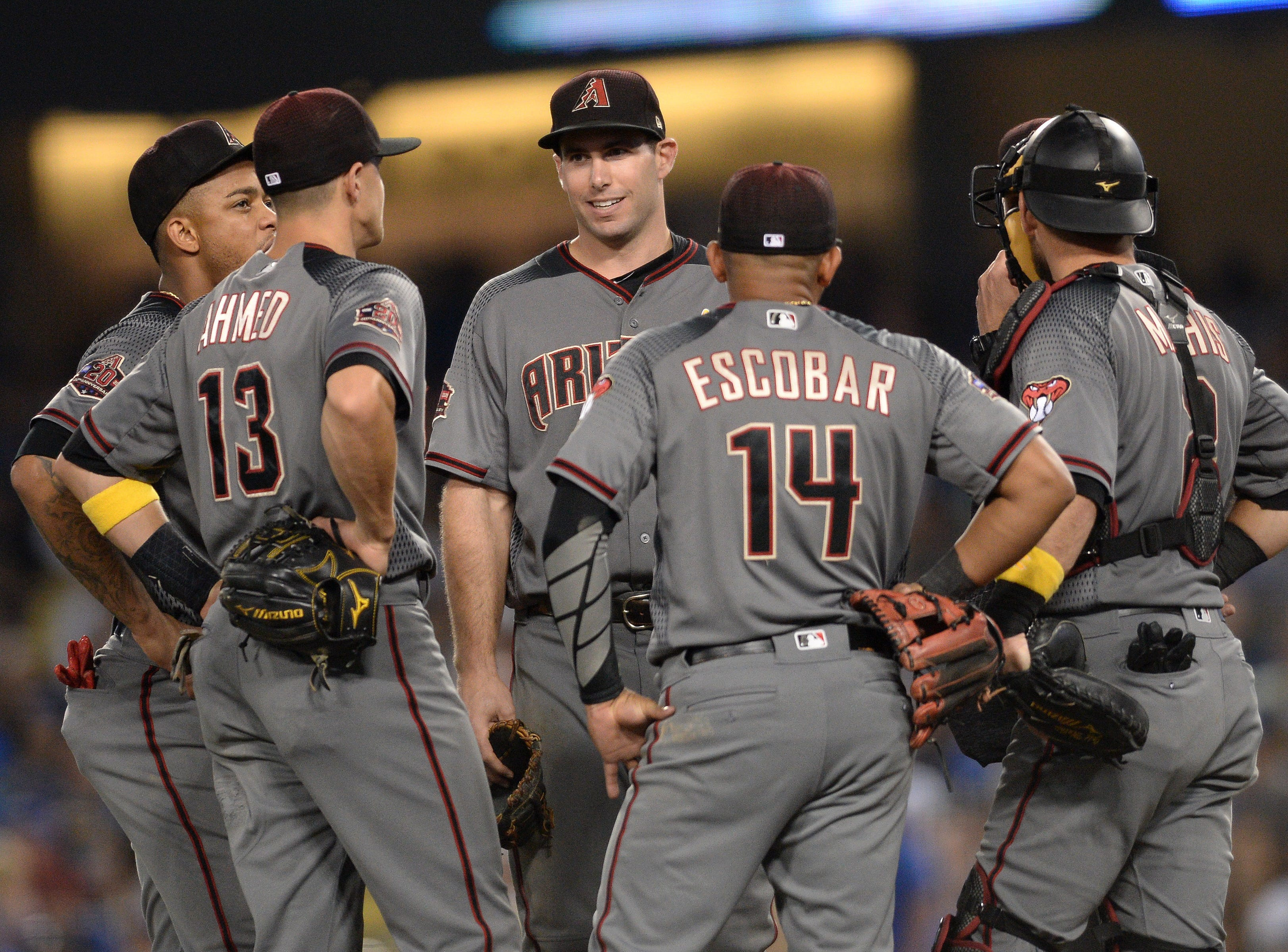Sep 1, 2018; Los Angeles, CA, USA; Arizona Diamondbacks players meet at the mound during a pitching change during the seventh inning against the Arizona Diamondbacks at Dodger Stadium.