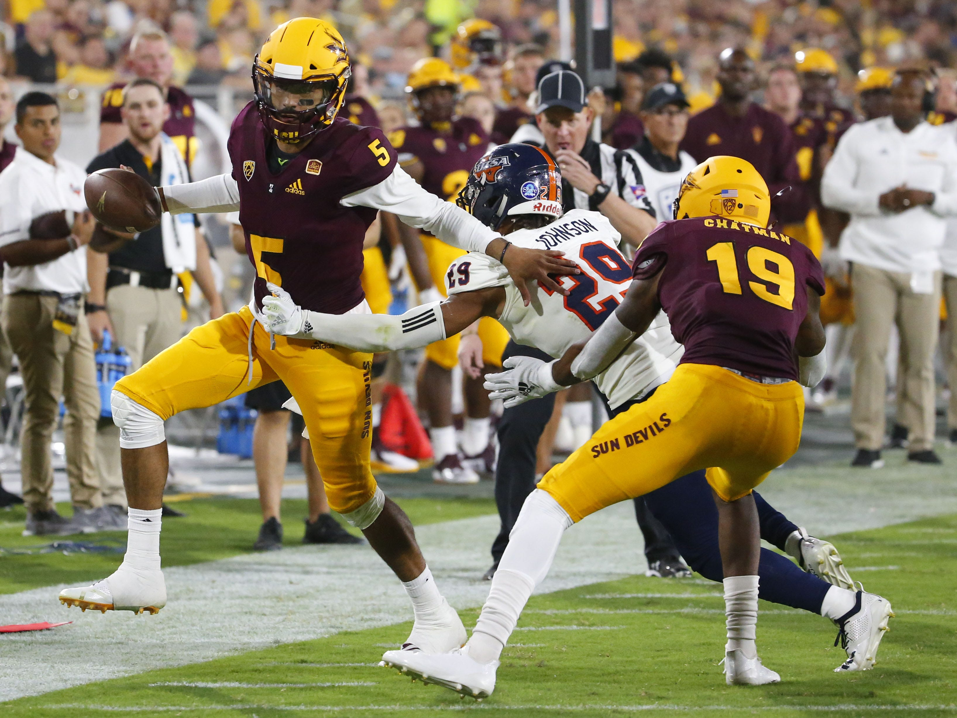 Arizona State Sun Devils quarterback Manny Wilkins (5) is pushed out of bounds by UTSA Roadrunners cornerback Clayton Johnson (29) during a football game at Sun Devil Stadium in Tempe on September 1, 2018.