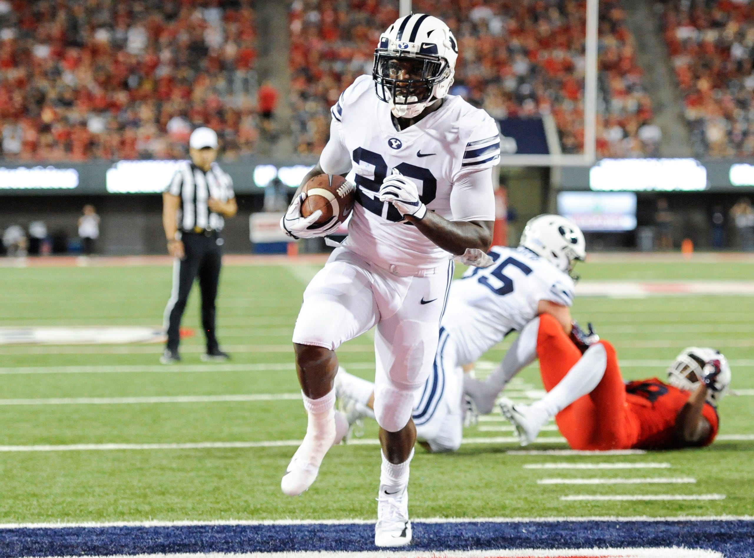 Sep 1, 2018; Tucson, AZ, USA; Brigham Young Cougars running back Squally Canada (22) runs the ball for a touchdown againt the Arizona Wildcats during the first half at Arizona Stadium.
