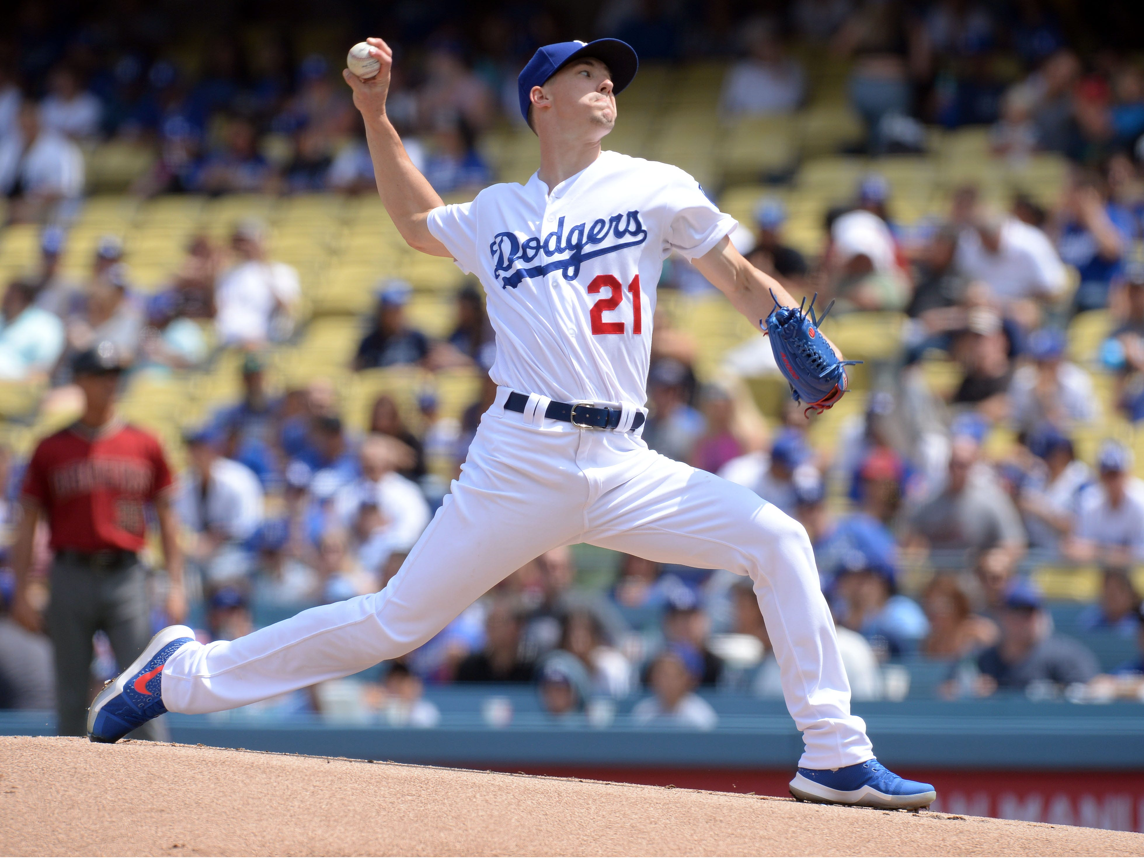 September 2, 2018; Los Angeles, CA, USA; Los Angeles Dodgers starting pitcher Walker Buehler (21) throws against the Arizona Diamondbacks in the first inning at Dodger Stadium. Mandatory Credit: Gary A. Vasquez-USA TODAY Sports
