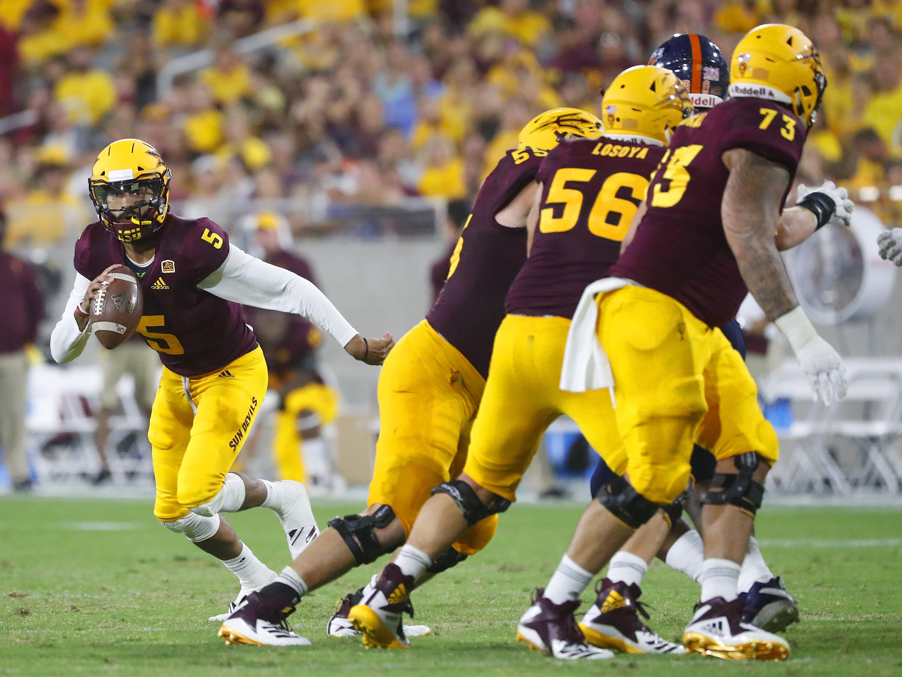 Arizona State Sun Devils quarterback Manny Wilkins (5) scrambles against UTSA during the second half at Sun Devil Stadium in Tempe, Ariz. on Sept. 1, 2018.