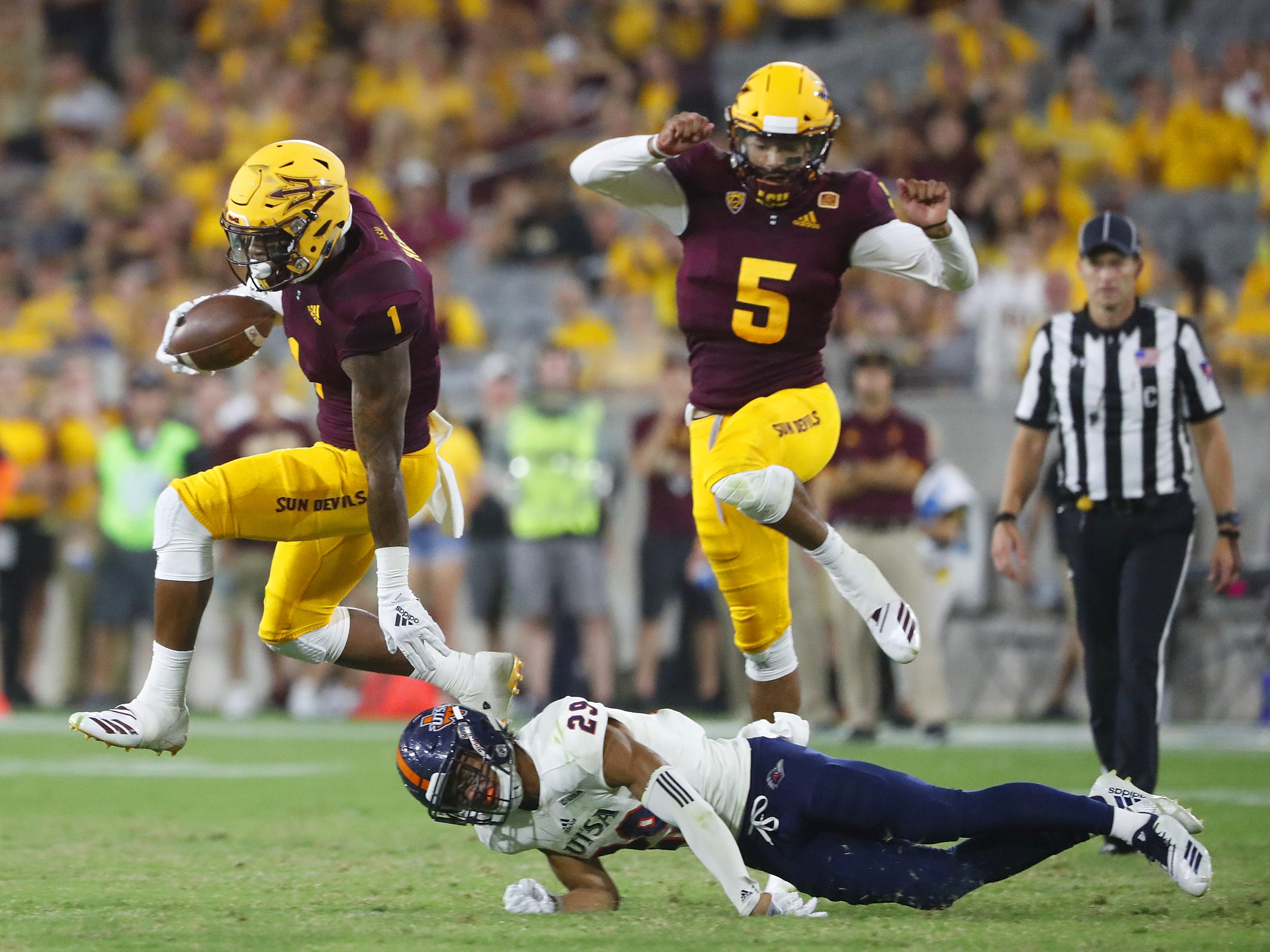 Arizona State Sun Devils wide receiver N'Keal Harry (1) jumps over a tackle from UTSA Roadrunners cornerback Clayton Johnson (29) on his way to a touchdown during the second half at Sun Devil Stadium in Tempe, Ariz. on Sept. 1, 2018.