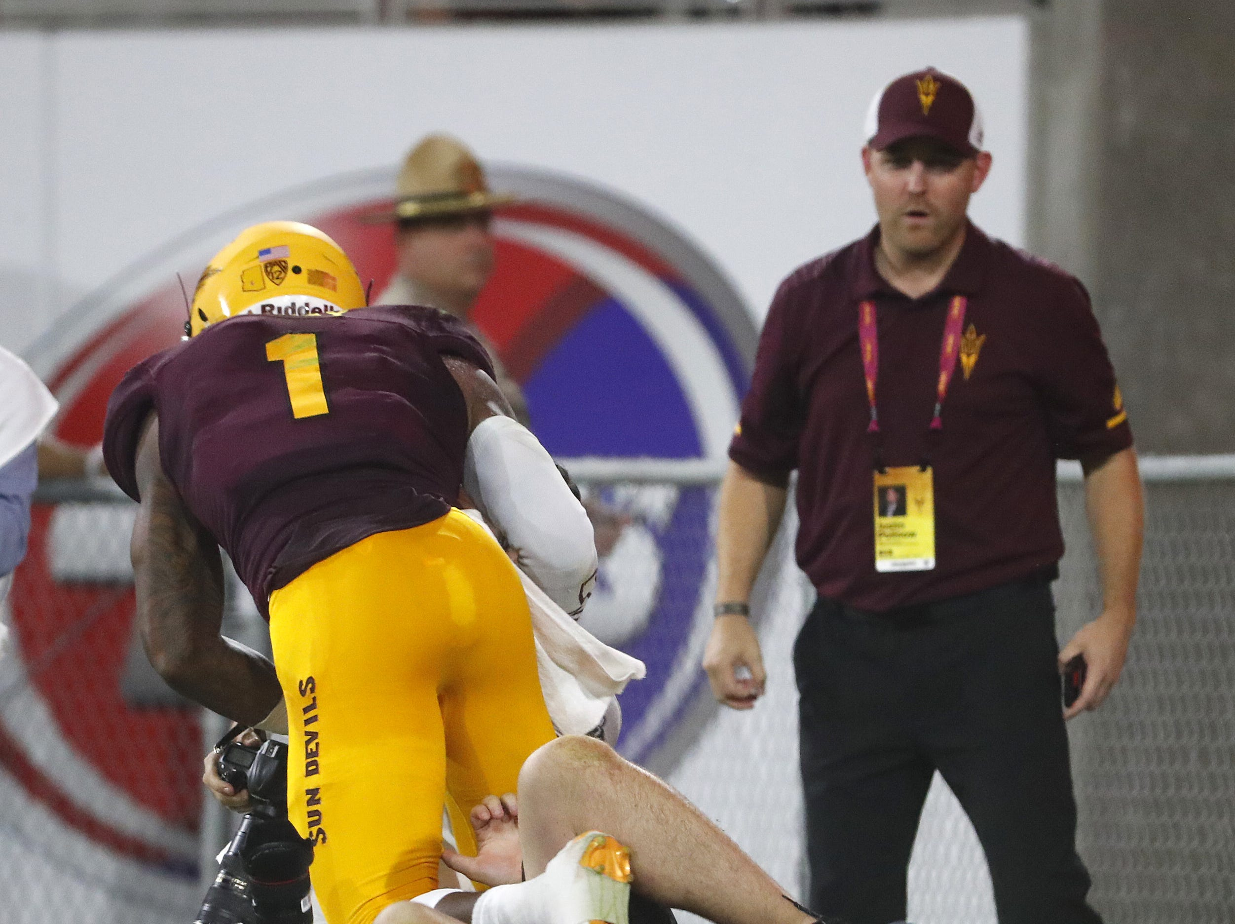 ASU's Arizona State Sun Devils wide receiver N'Keal Harry (1) falls over a photographer while celebrating a 58-yard touchdown reception against UTSA Roadrunners in the first quarter at Sun Devil Stadium in Tempe, Ariz. on Sept. 1, 2018.