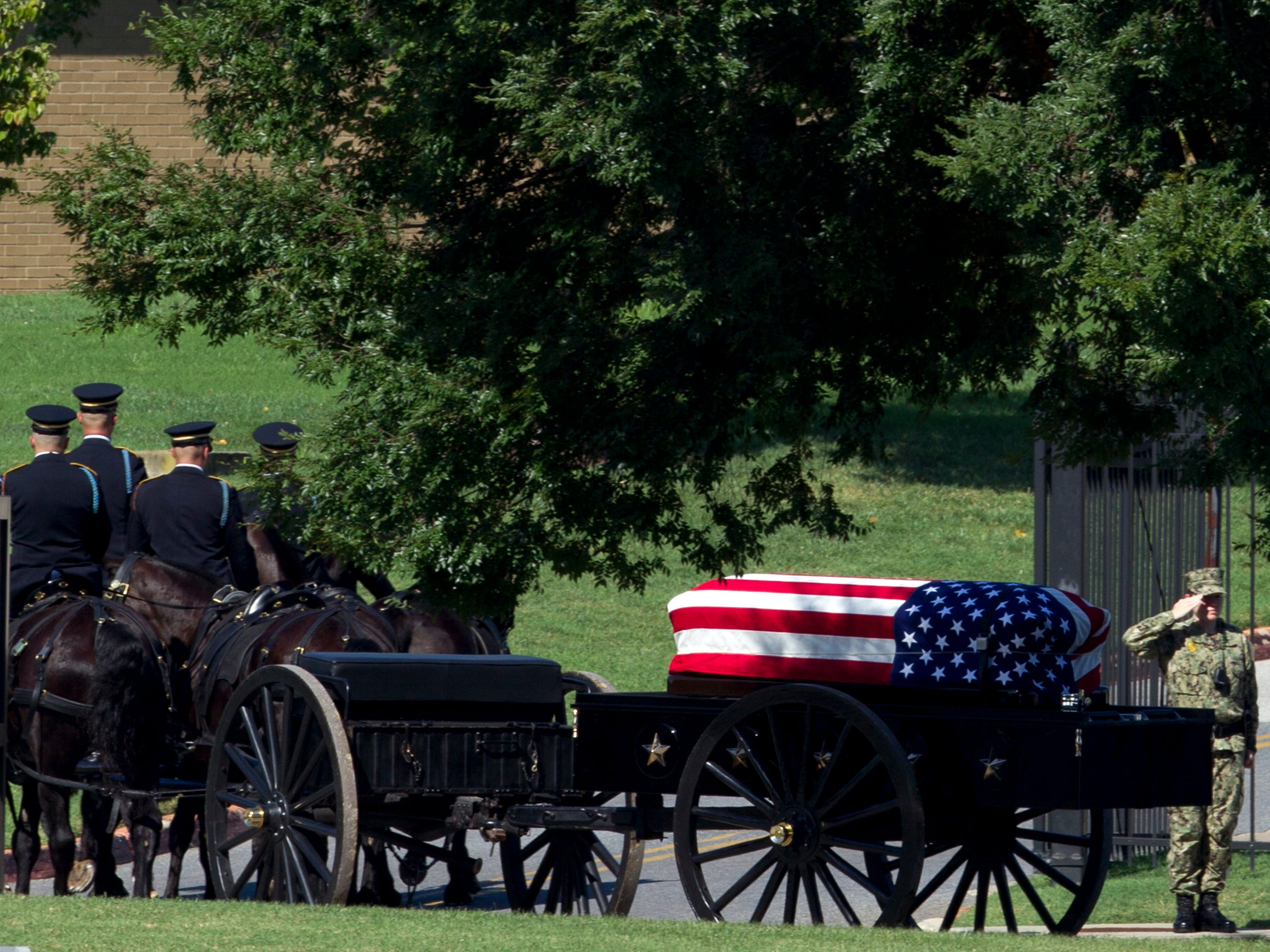A horse drawn caisson carries the casket containing the remains of Sen. John McCain to his burial site at the United States Naval Academy Cemetery in Annapolis, Maryland, Sep. 2, 2018. McCain died Aug. 25 from brain cancer at age 81.