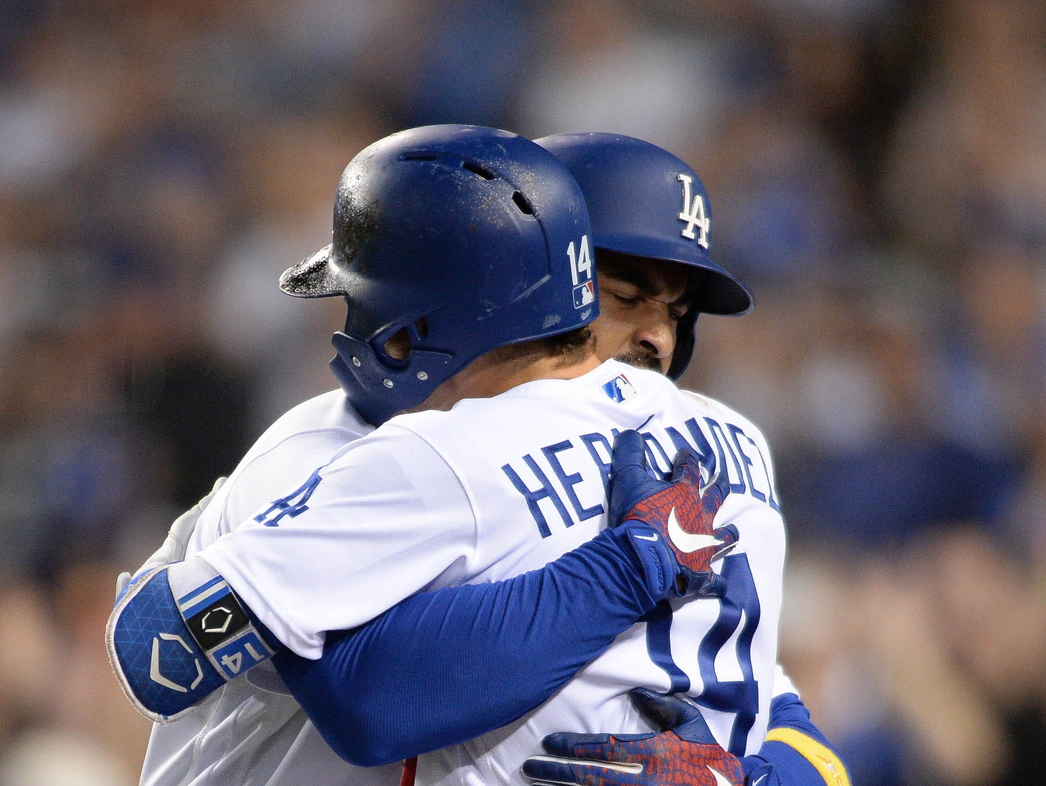 Sep 1, 2018; Los Angeles, CA, USA; Los Angeles Dodgers left fielder Matt Kemp (left) is greeted by center fielder Enrique Hernandez (14) after Kemp hit a three-run home run during the eighth inning against the Arizona Diamondbacks at Dodger Stadium. Mandatory Credit: Orlando Ramirez-USA TODAY Sports