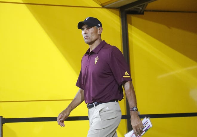 ASU's head coach Herm Edwards walks out to take the field against UTSA at Sun Devil Stadium in Tempe, Ariz. on Sept. 1, 2018.