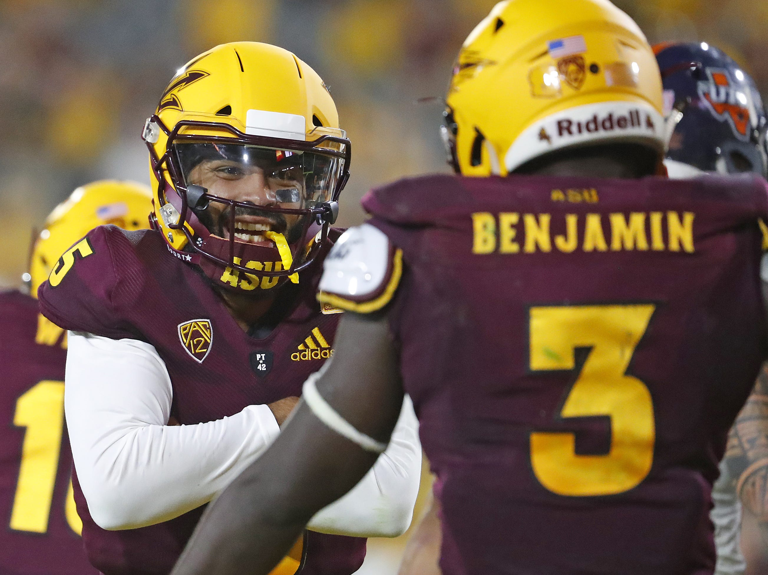 Arizona State Sun Devils quarterback Manny Wilkins (5) celebrates with Arizona State Sun Devils running back Eno Benjamin (3) after Benjamin scored a touchdown against UTSA during the second half at Sun Devil Stadium in Tempe, Ariz. on Sept. 1, 2018.