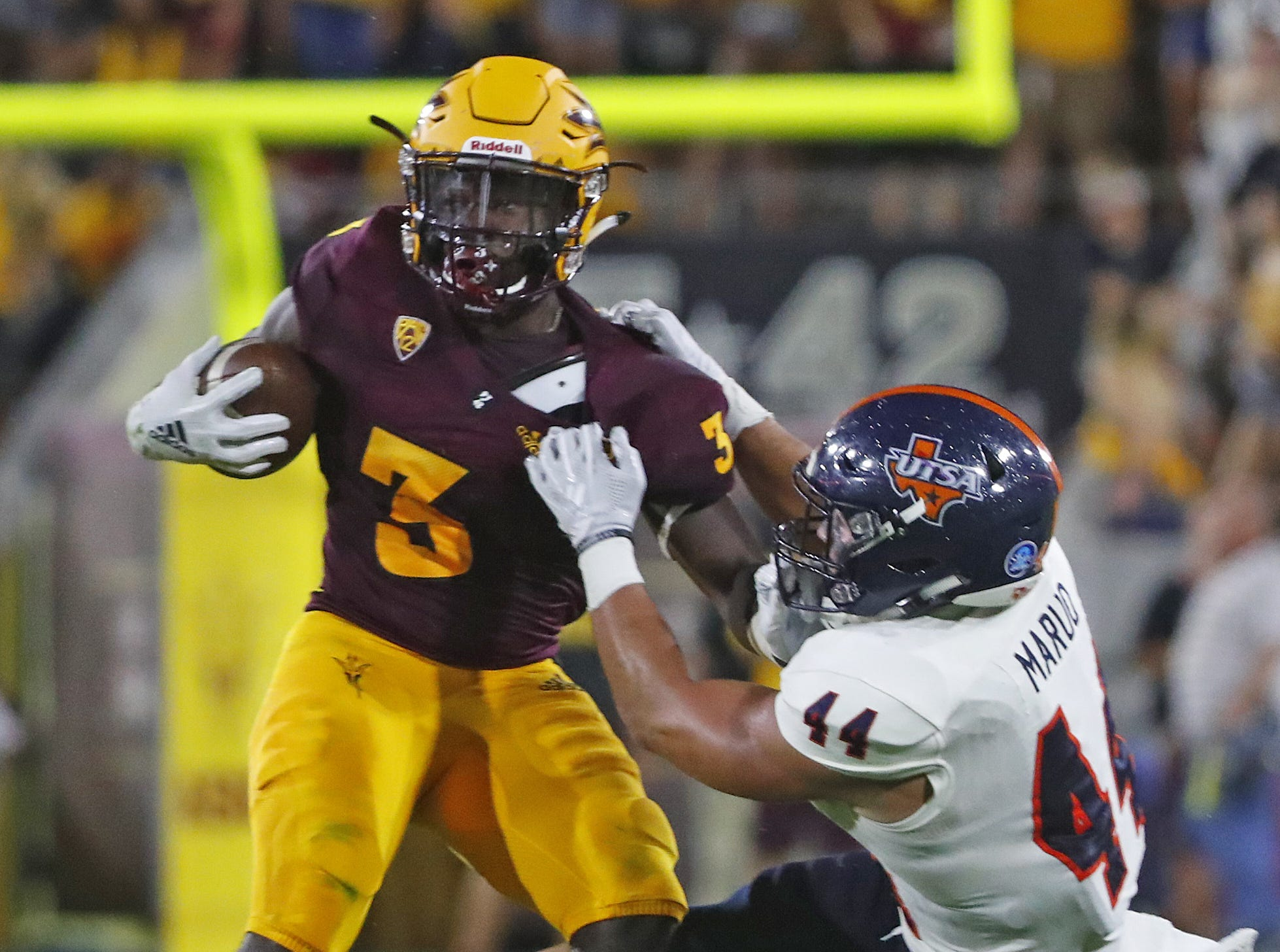 UTSA Roadrunners linebacker Les Maruo (44) tackles Arizona State Sun Devils running back Eno Benjamin (3) during the first half at Sun Devil Stadium in Tempe, Ariz. on Sept. 1, 2018.