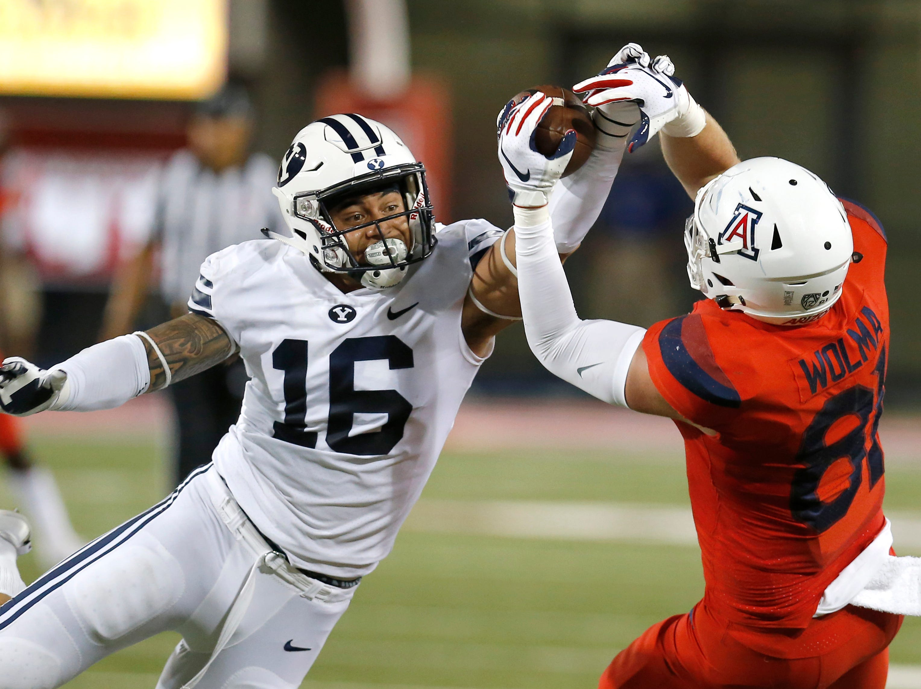 BYU  linebacker Sione Takitaki (16) breaks up a pass intended for Arizona tight end Bryce Wolma (81) during the first half of an NCAA college football game Saturday, Sept. 1, 2018, in Tucson, Ariz.