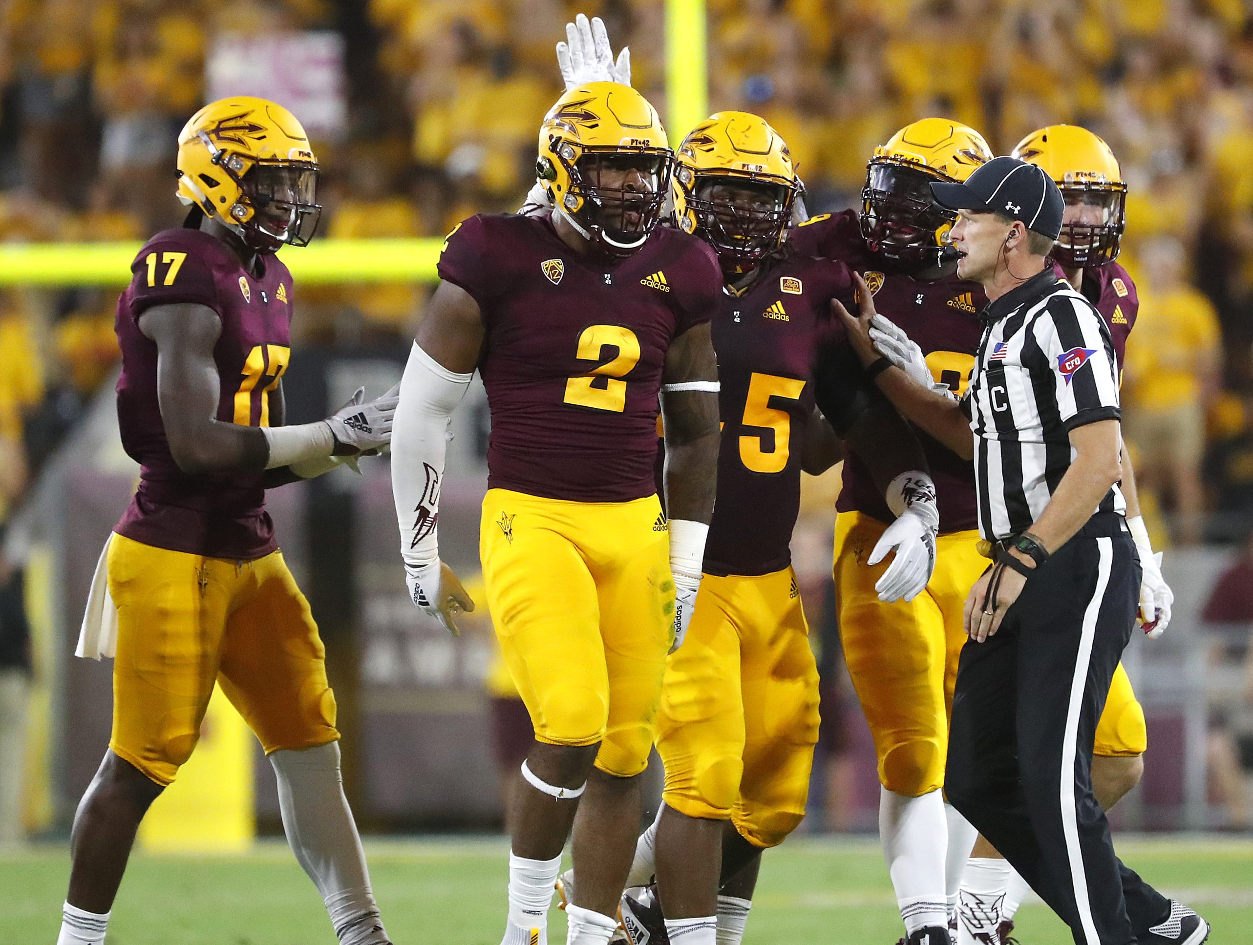 Arizona State Sun Devils teammates congratulate Arizona State Sun Devils defensive lineman Darius Slade (2) after he recovered a fumble during the first half against UTSA Roadrunners at Sun Devil Stadium in Tempe, Ariz. on Sept. 1, 2018.