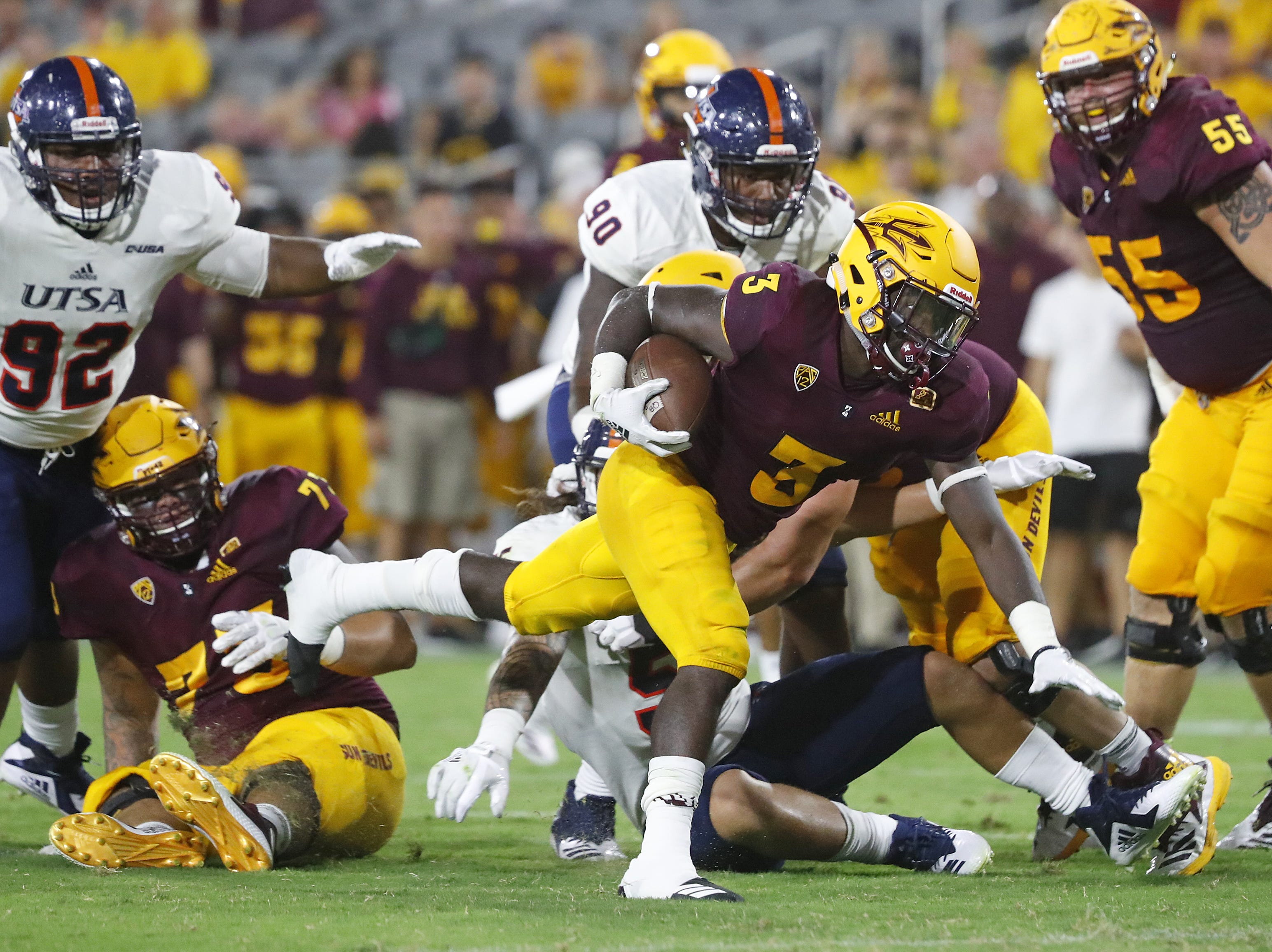 Arizona State Sun Devils running back Eno Benjamin (3) runs for a first done during the second half at Sun Devil Stadium in Tempe, Ariz. on Sept. 1, 2018.