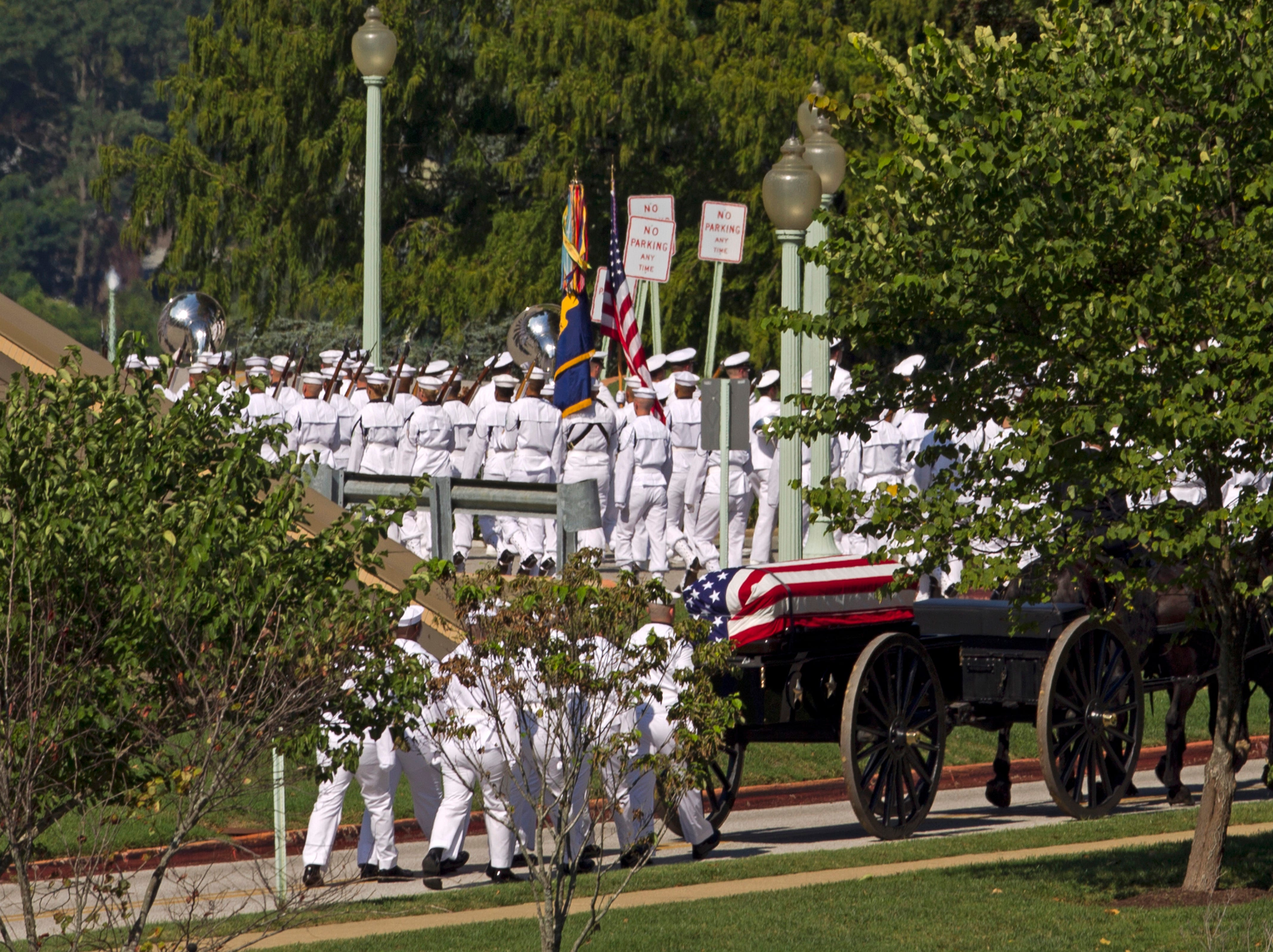 A horse-drawn caisson carries the casket containing the remains of Sen. John McCain to his burial site at the United States Naval Academy Cemetery in Annapolis, Maryland, Sept. 2, 2018. McCain died Aug. 25 from brain cancer at age 81.