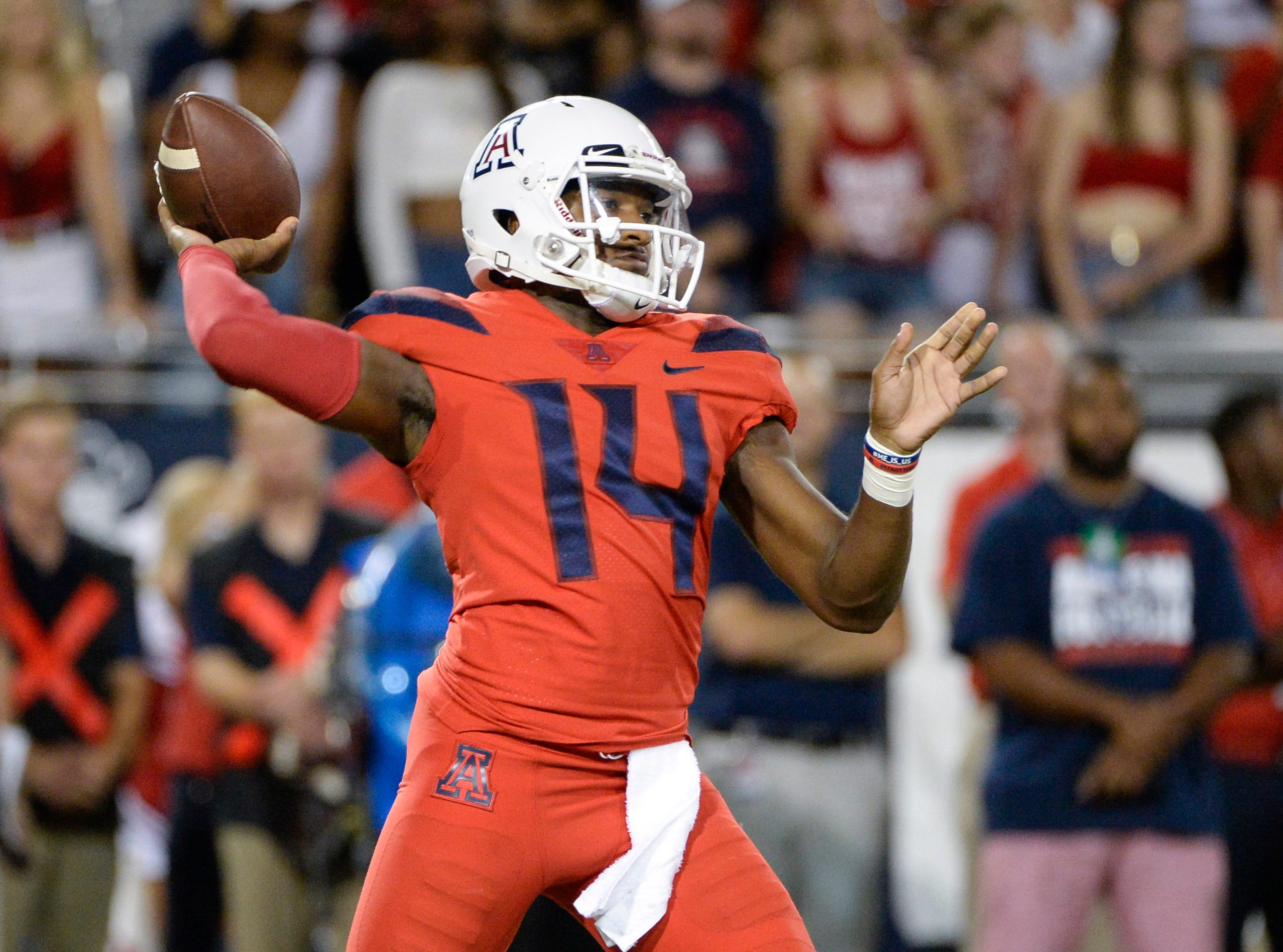 Sep 1, 2018; Tucson, AZ, USA; Arizona Wildcats quarterback Khalil Tate (14) passes the ball against the Brigham Young Cougars during the first quarter at Arizona Stadium.