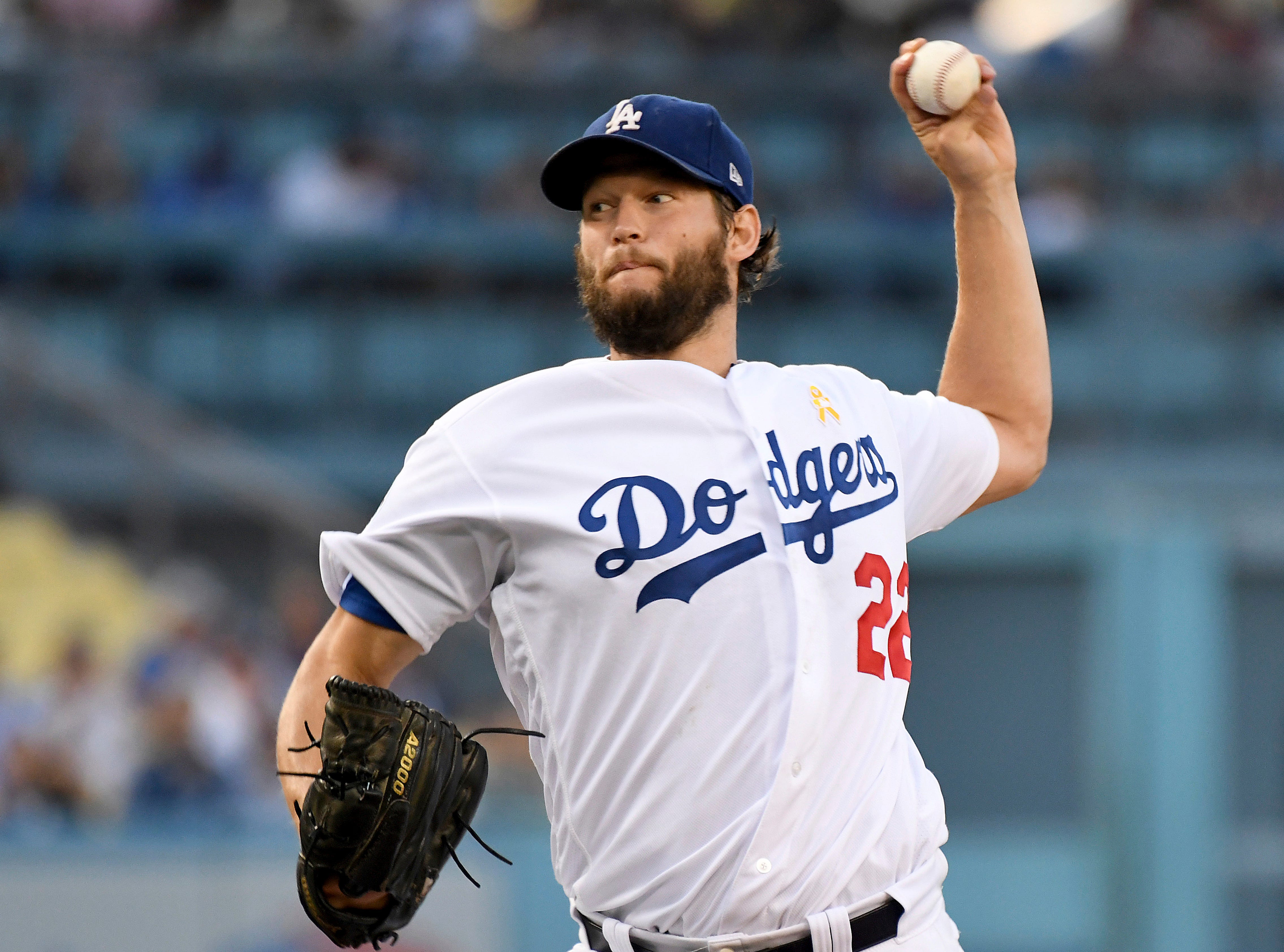 Los Angeles Dodgers pitcher Clayton Kershaw throws to the plate during the first inning of a baseball game against the Arizona Diamondbacks, Saturday, Sept. 1, 2018, in Los Angeles.