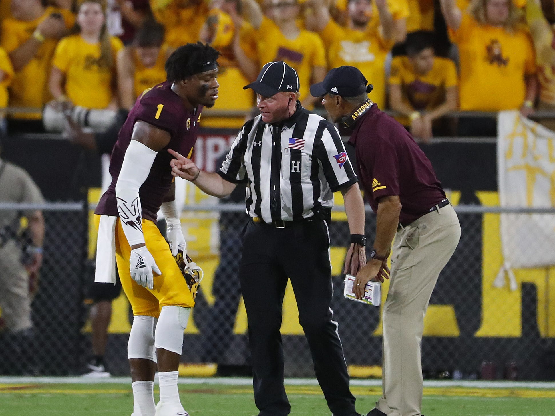 Arizona State Sun Devils wide receiver N'Keal Harry (1) and head coach Herm Edwards talk to an official during the first half at Sun Devil Stadium in Tempe, Ariz. on Sept. 1, 2018.