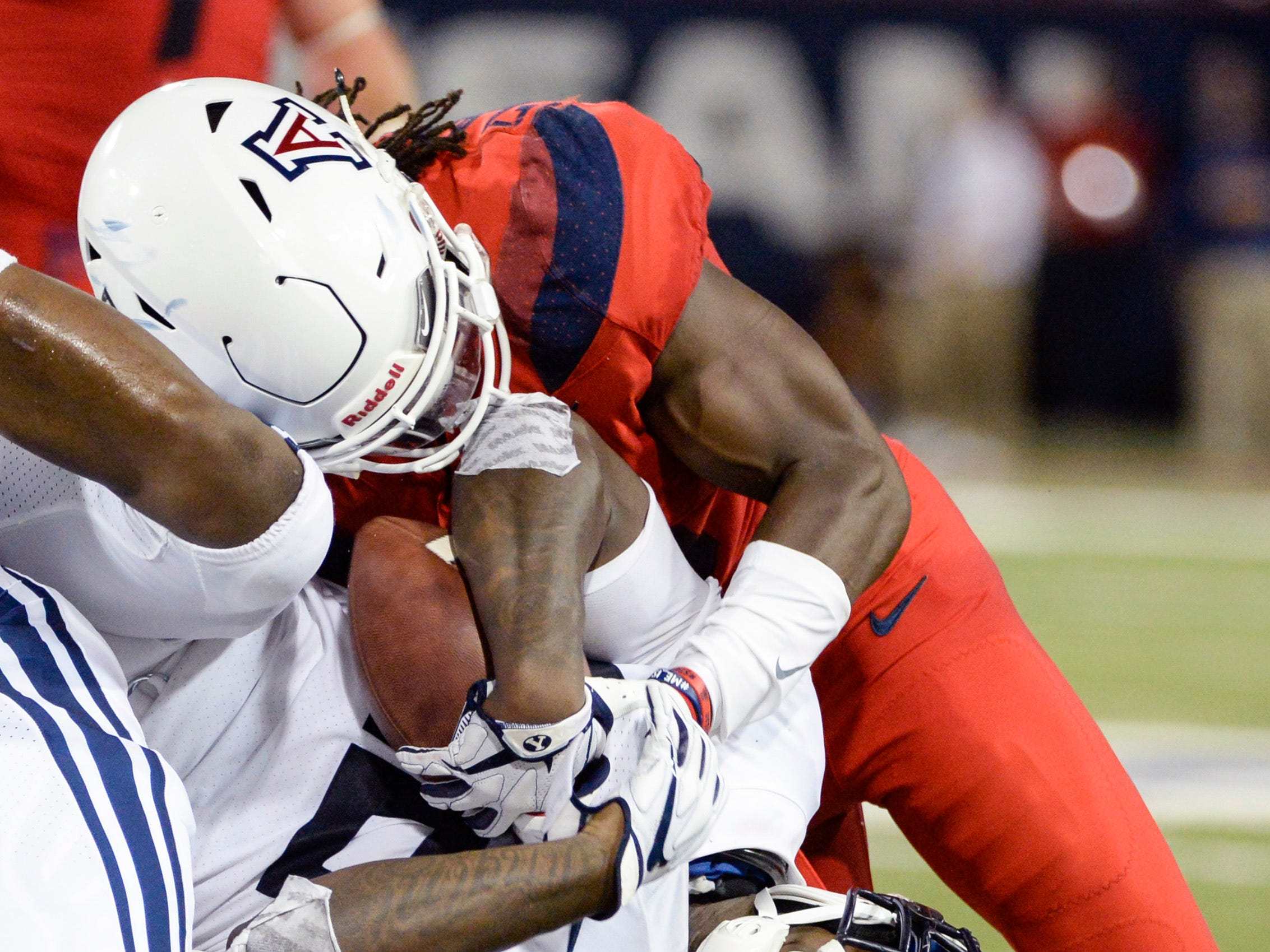 Sep 1, 2018; Tucson, AZ, USA; Brigham Young Cougars running back Squally Canada (22) is tackled by Arizona Wildcats safety Demetrius Flannigan-Fowles (6) during the first half at Arizona Stadium.