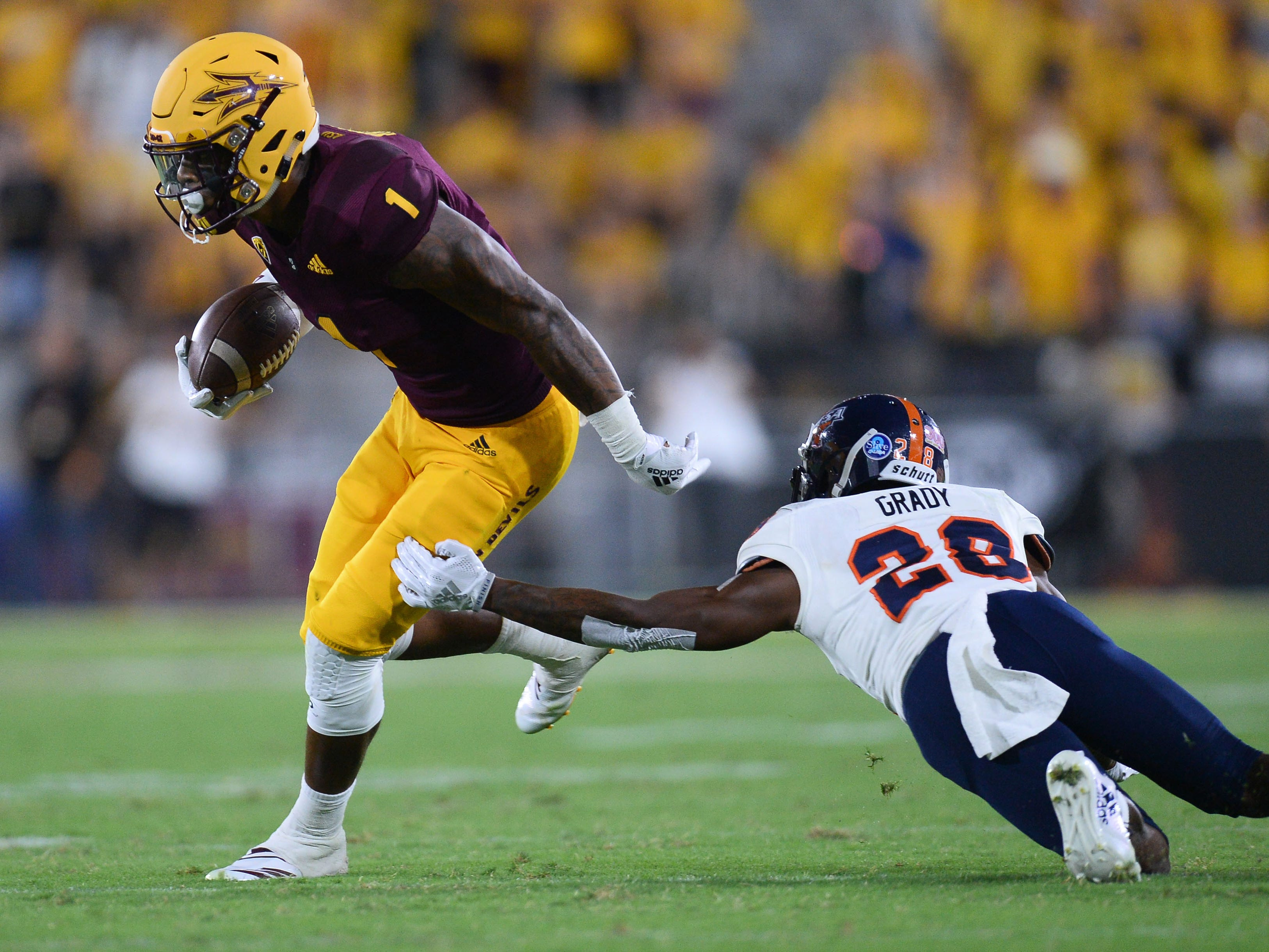 Sep 1, 2018; Tempe, AZ, USA; Arizona State Sun Devils wide receiver N'Keal Harry (1) slips by the tackle of UTSA Roadrunners cornerback Cassius Grady (28) en route to a touchdown during the second half at Sun Devil Stadium.