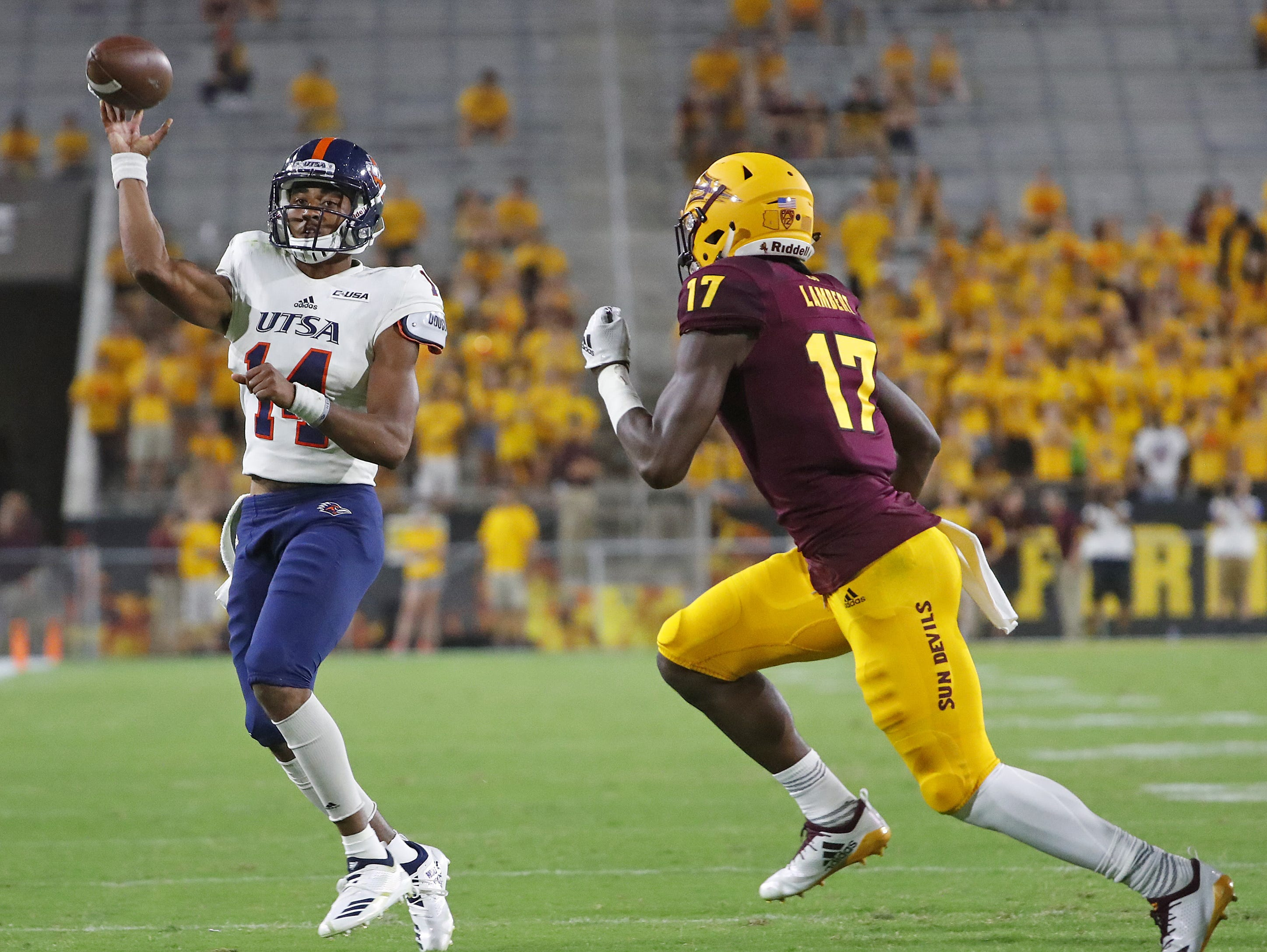 UTSA Roadrunners quarterback Cordale Grundy (14) throws a pass on the run under pressure from \Stanley Lambert (17) during the second half at Sun Devil Stadium in Tempe, Ariz. on Sept. 1, 2018.