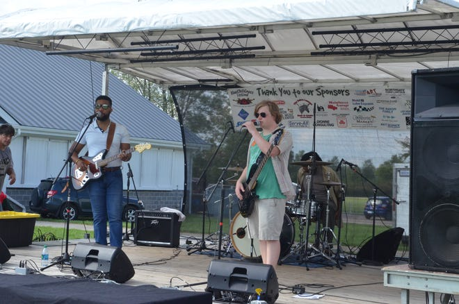 J Walker and the Crossing Guards prepare for their set at the 2018 BlueChiliGrass Festival on Sept. 2, 2018.