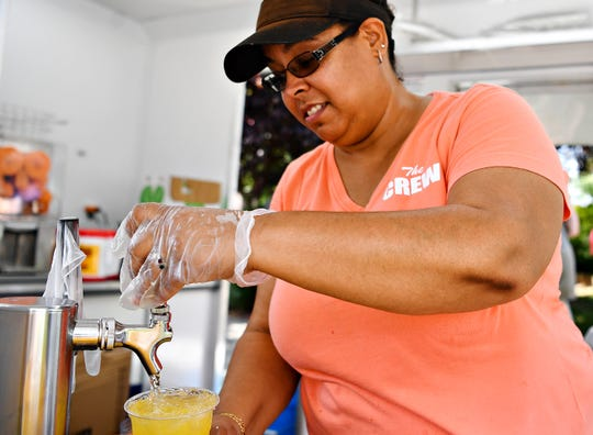 Kara Ile, of Stacey's OrangeAde during What the Food Trucks at Penn Park in York City, Sunday, Sept. 2, 2018. Dawn J. Sagert photo