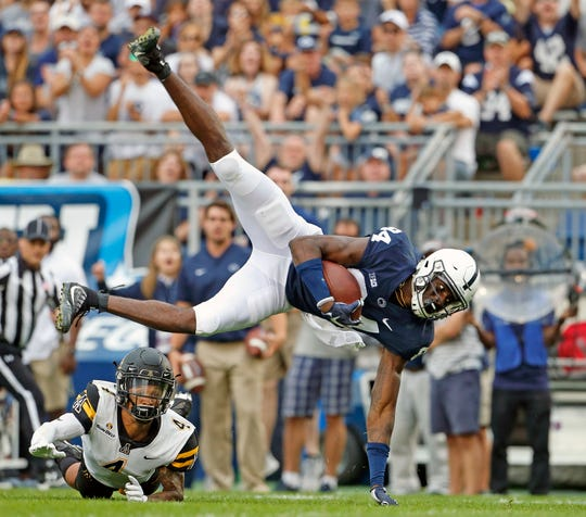 Penn State's Juwan Johnson (84) makes a catch in front of Appalachian State's Clifton Duck (4) during the second half of an NCAA college football game in State College, Pa., Saturday, Sept. 1, 2018. Penn State won 45-38 in overtime. (AP Photo/Chris Knight)