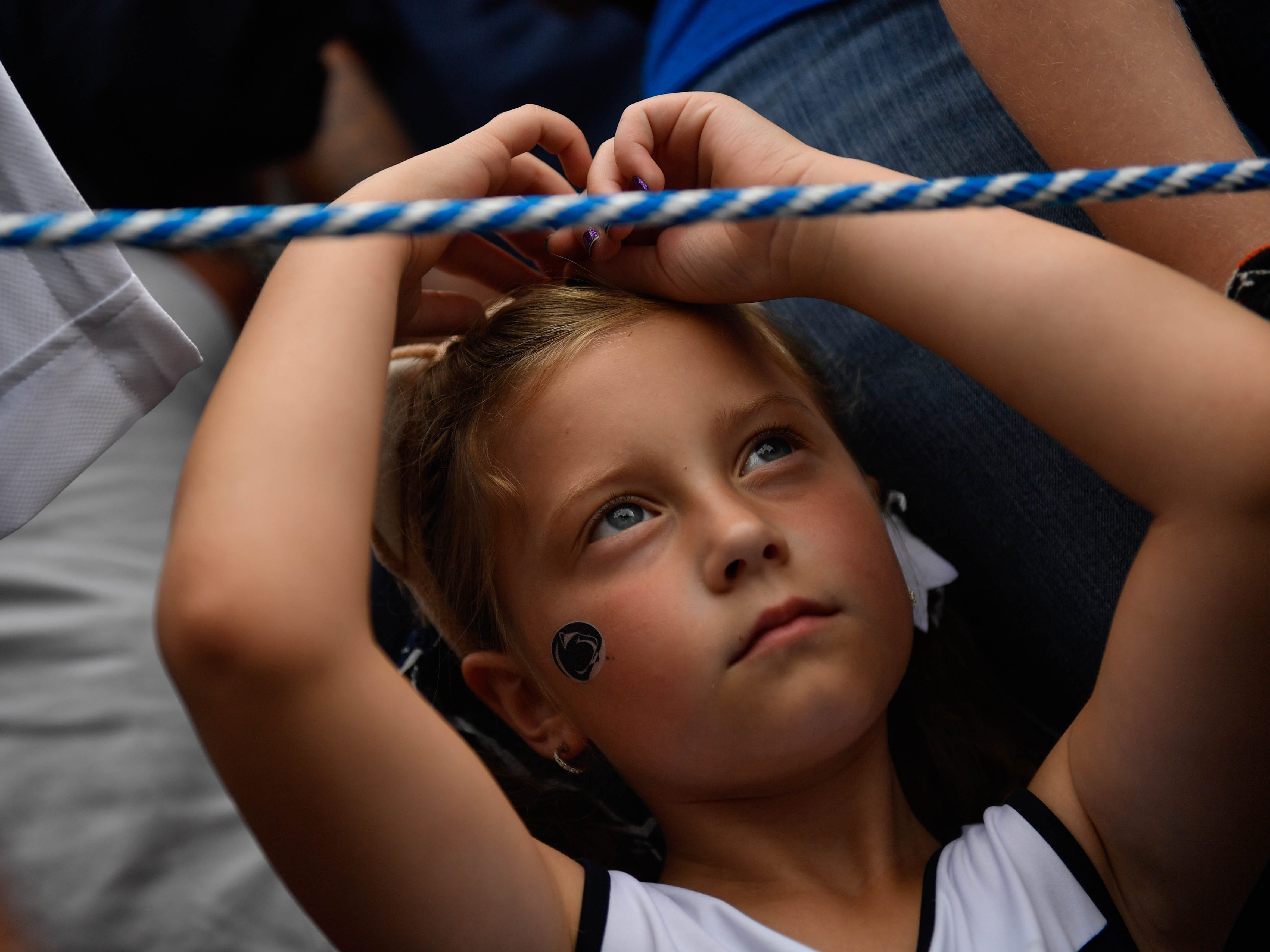 A young Penn State fan patiently waits for the team to arrive at the opener against Appalachian State at Beaver Stadium on September 1, 2018.