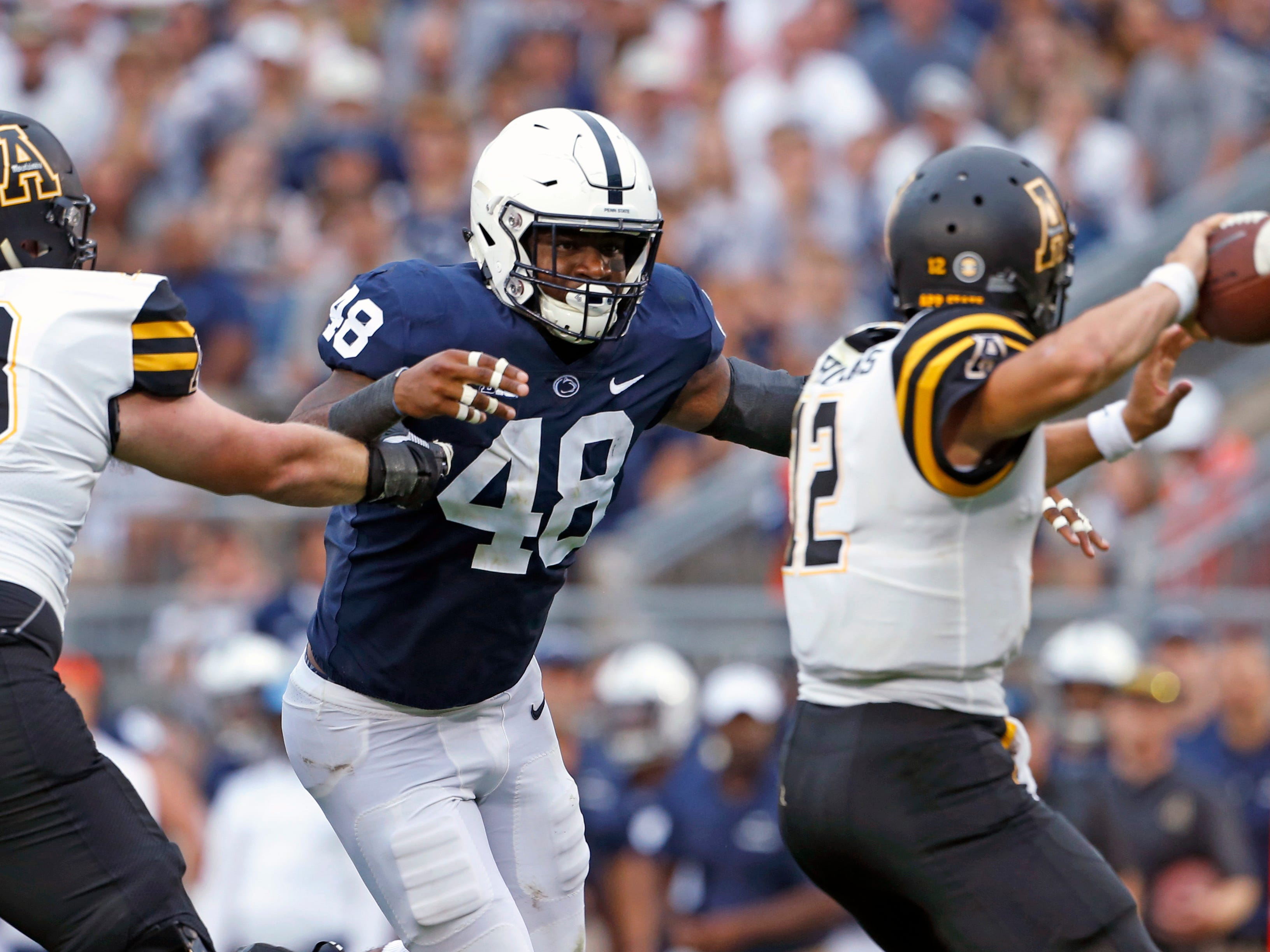 Penn State's Shareef Miller (48) goes after Appalachian State quarterback Zac Thomas (12) during the second half of an NCAA college football game in State College, Pa., Saturday, Sept. 1, 2018. Penn State won 45-38 in overtime. (AP Photo/Chris Knight)