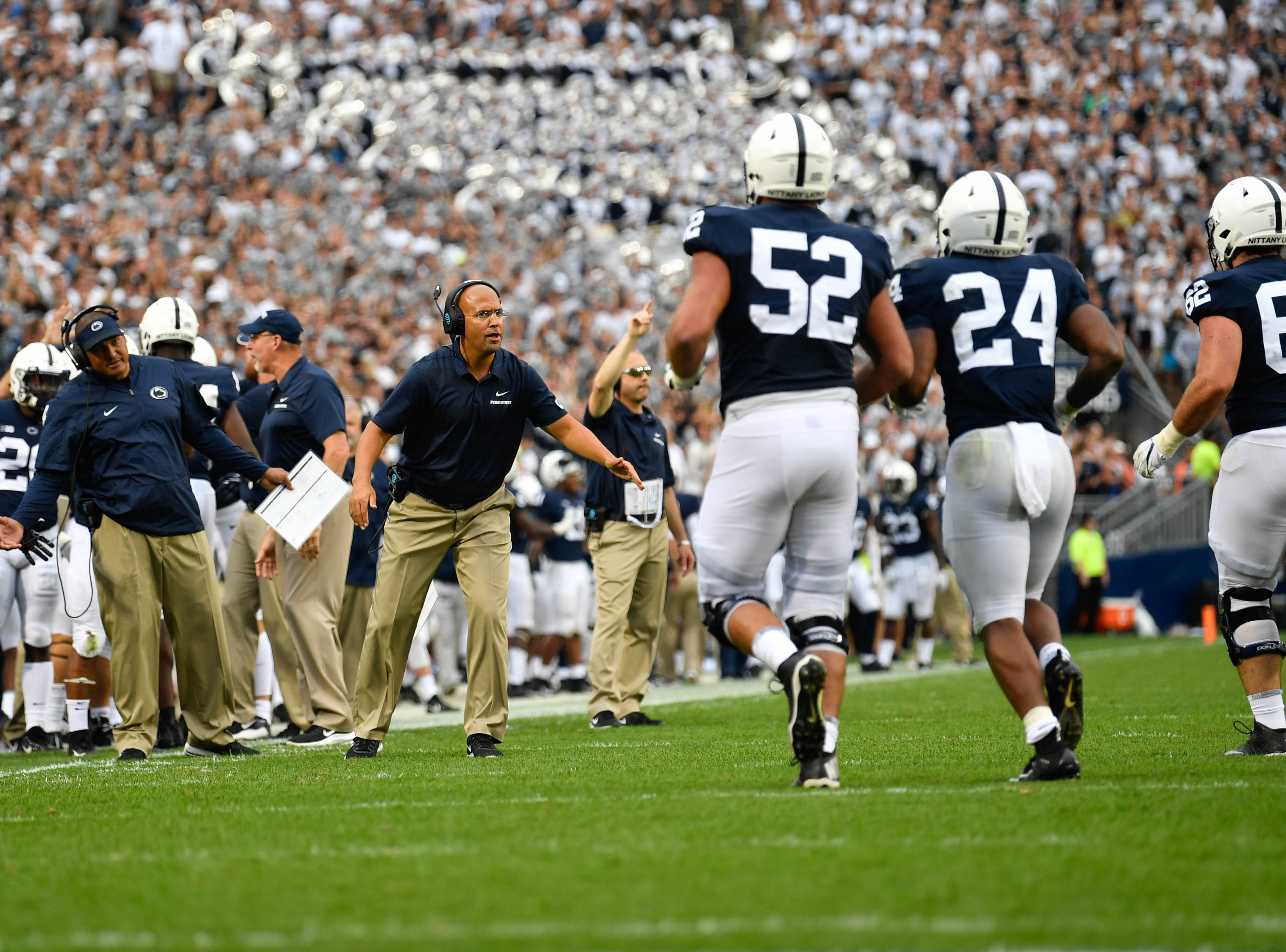 James Franklin coaches players as they come off the field during the Penn State opener against Appalachian State at Beaver Stadium on September 1, 2018.