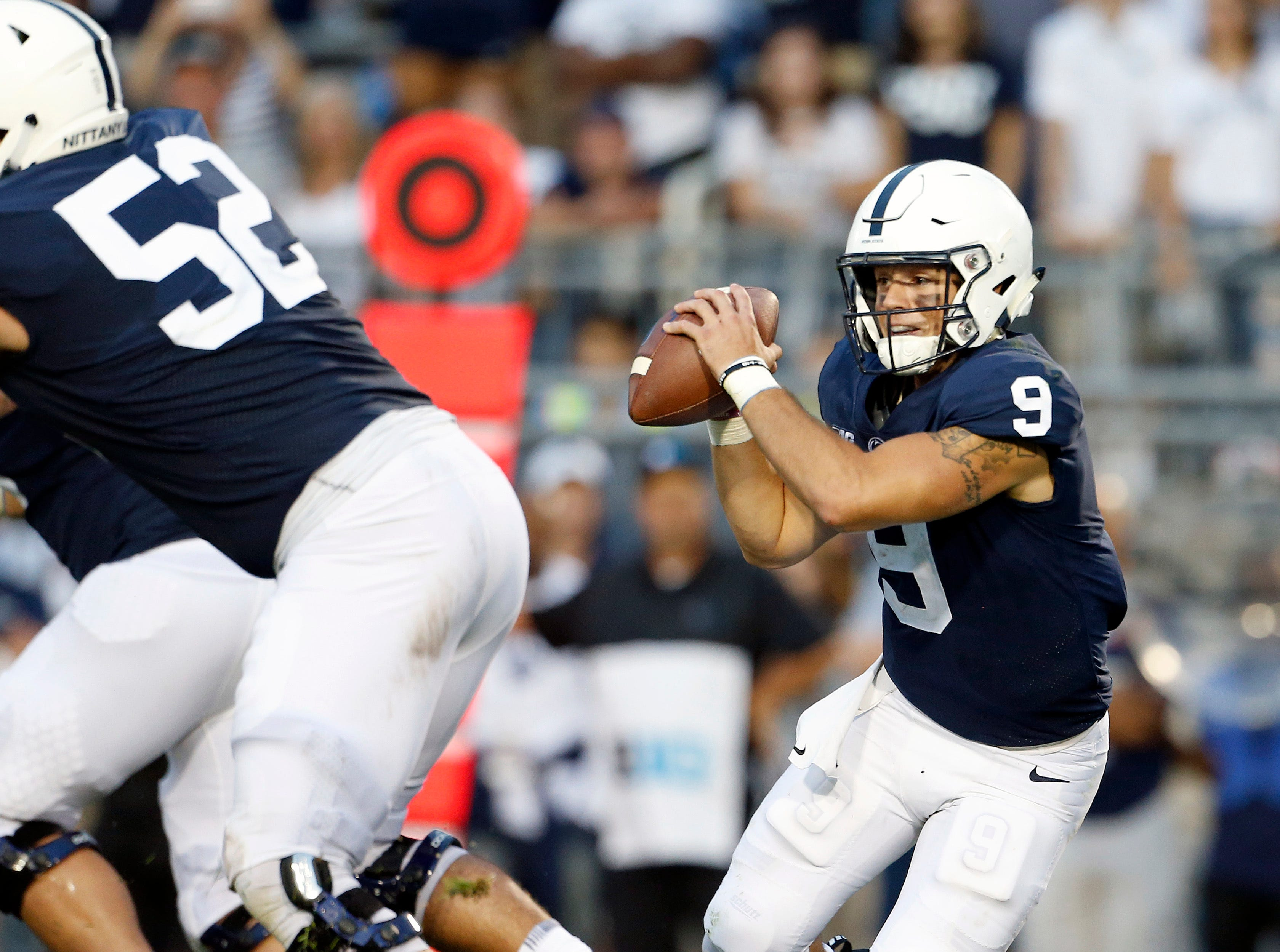 Penn State quarterback Trace McSorley (9) scrambles out of the pocket against during the second half of an NCAA college football game against Appalachian State in State College, Pa., Saturday, Sept. 1, 2018. Penn State won 45-38 in overtime. (AP Photo/Chris Knight)