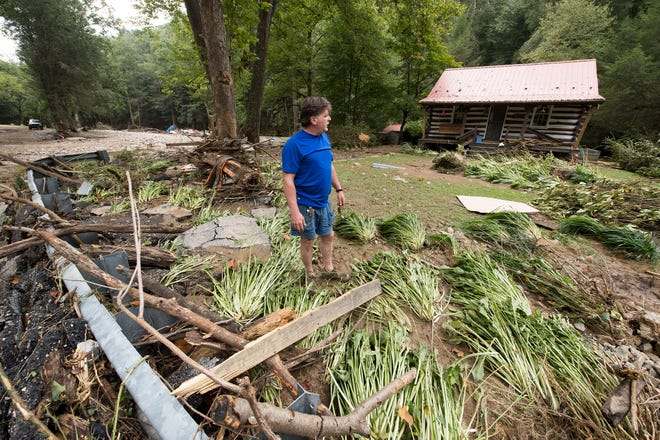 David Montgomery starts cleaning up his property Sunday.