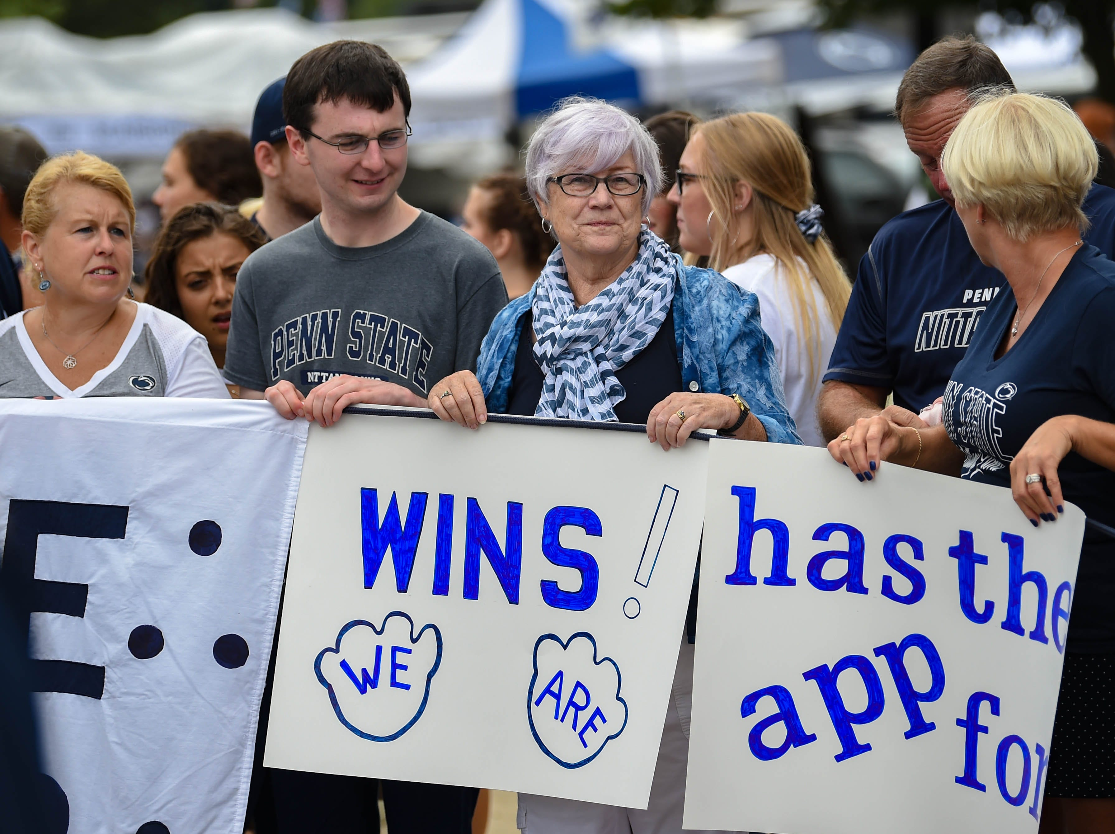 Fans proudly display their homemade signs as the Penn State players enter Beaver Stadium on September 1, 2018.