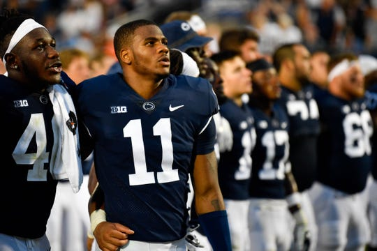 Micah Parsons (11) sings the Penn State fight song with his teammates after their 45-38 victory over Appalachian State, September 1, 2018.