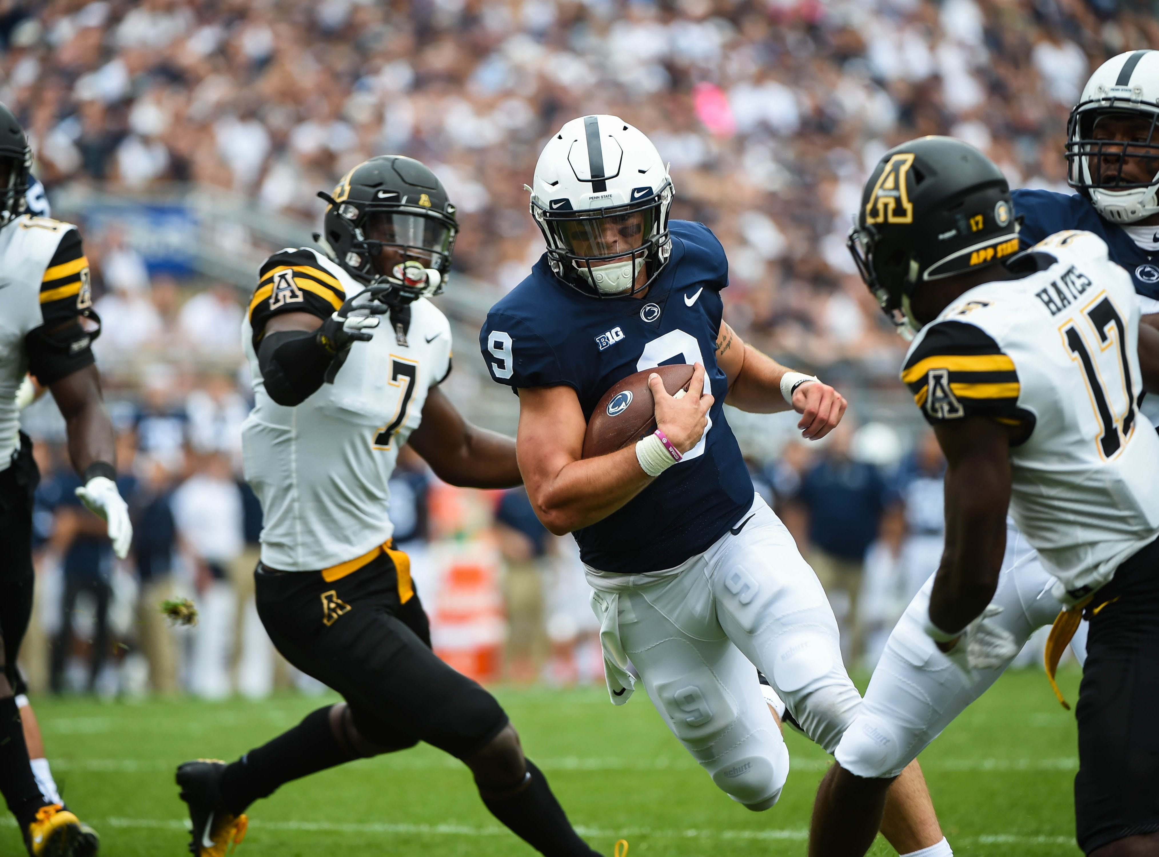 Trace McSorley (9) slips past the Appalachian State defense on September 1, 2018.