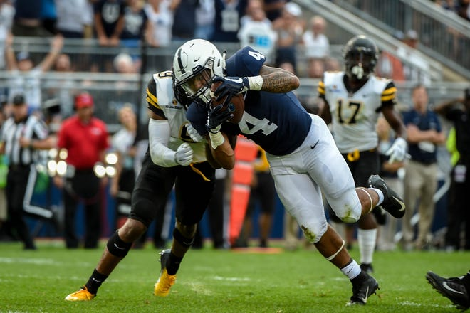 Ricky Slade (4) dives for the end zone during the Penn State opener against Appalachian State at Beaver Stadium on September 1, 2018.