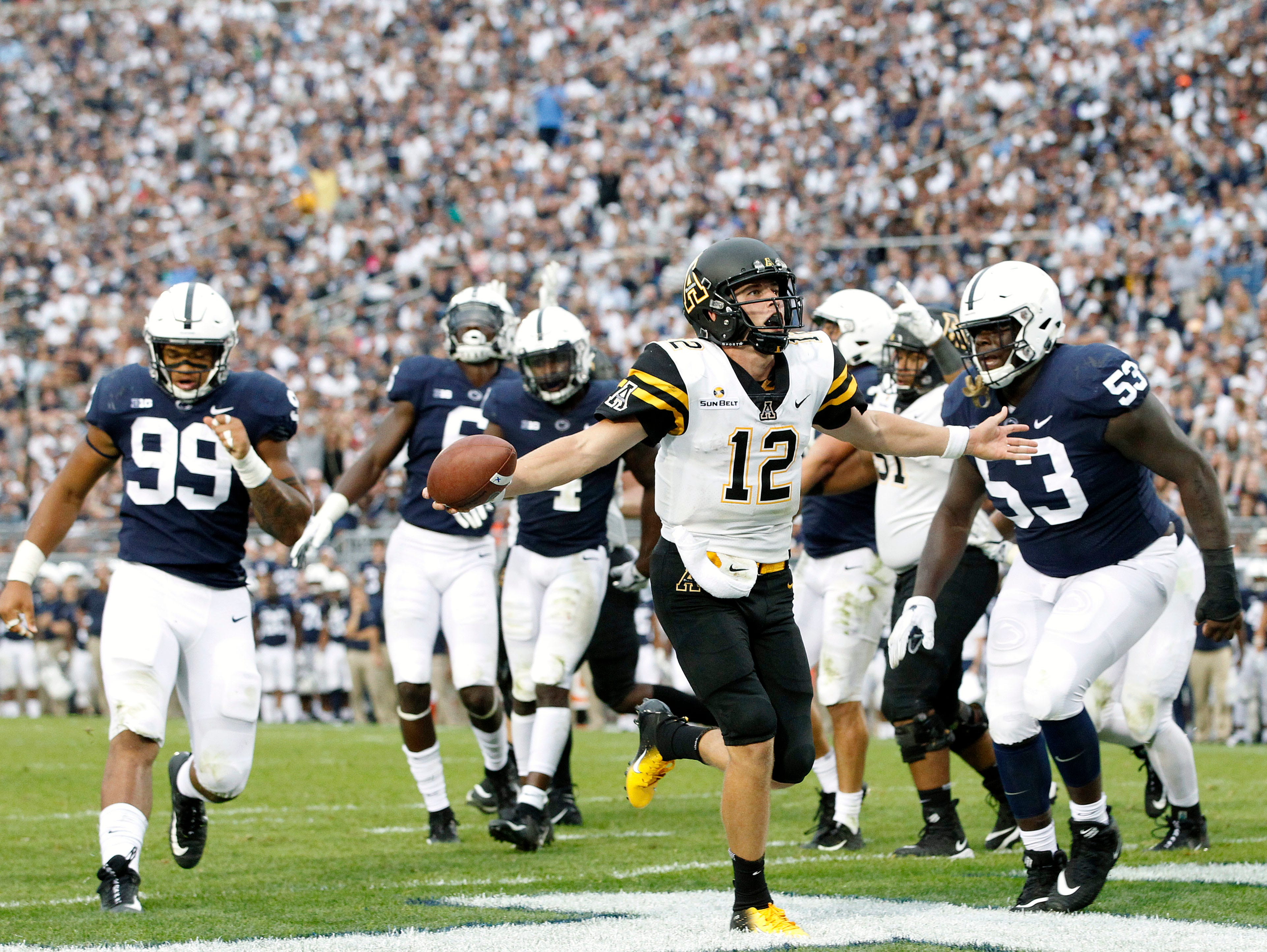 Appalachian State quarterback Zac Thomas (12) runs in for a touchdown against Penn State during the second half of an NCAA college football game in State College, Pa., Saturday, Sept. 1, 2018. Penn State won 45-38 in OT. (AP Photo/Chris Knight)