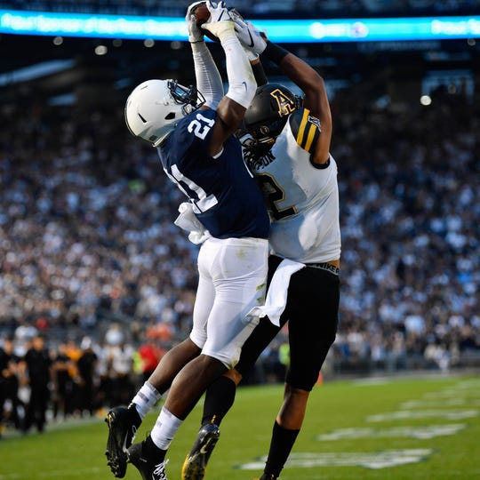 Amani Oruwariye (21) intercepts the ball, bringing an end to overtime and the game. Penn State defeated Appalachian State 45-38.