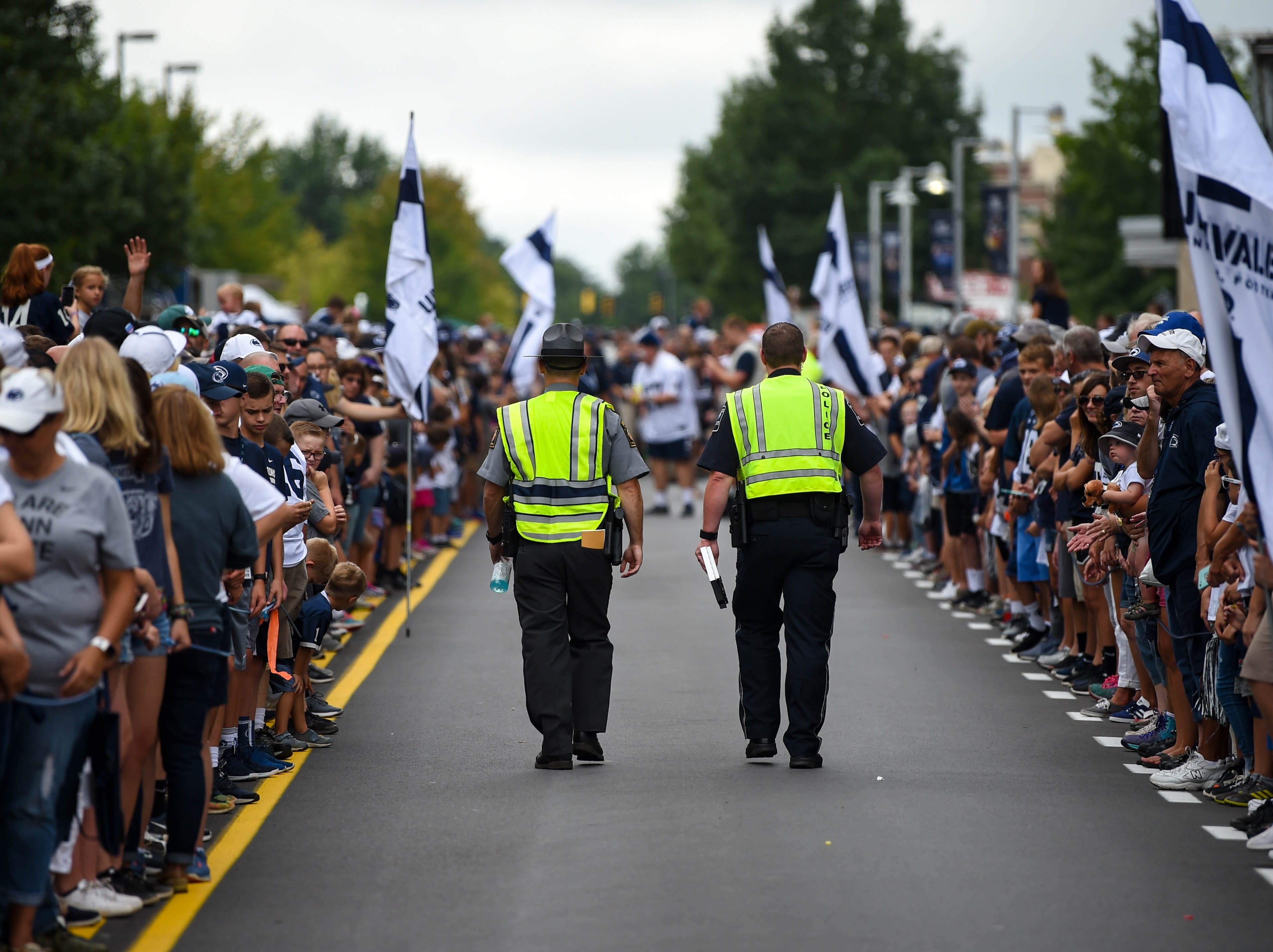 Penn State fans line both sides of the street eagerly awaiting Franklin and the rest of the team's arrival.