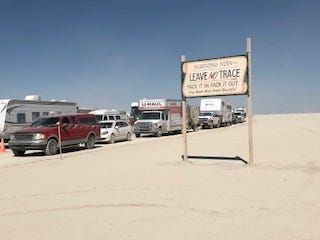 A line of cars waits at the exit point of Burning Man. Officials let groups of cars out in 45-minute intervals in order to ease congestion on the rural highway leading to Interstate 80.