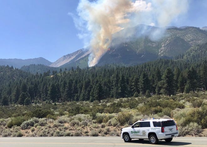 The Slide Fire burns up Slide Mountain on Sunday, Sept. 2, 2018 in this photo from the Washoe County Sheriff's Office. Search and rescue crews were working to locate a downed aircraft reported to have started the fire.