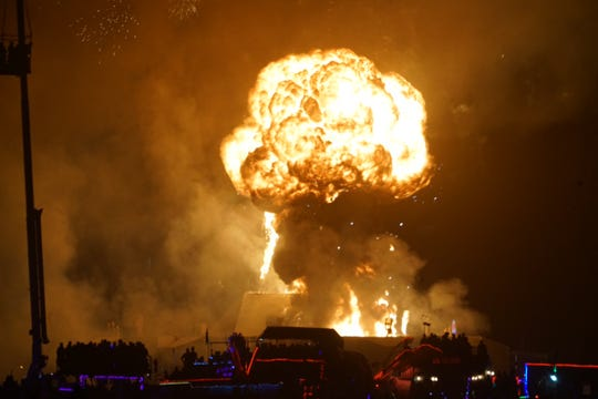 A fireball marks the pyrotechnic end to Burning Man, in which the giant effigy is burned on the final night of the weeklong arts festival in the Nevada desert.