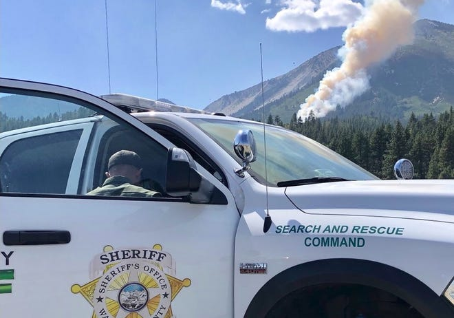 The Slide Fire burns up Slide Mountain on Sunday, Sept. 2, 2018 in this photo from the Washoe County Sheriff's Office. Search and rescue crews were working to evacuate hikers from the area and to locate a downed aircraft reported to have started the fire.