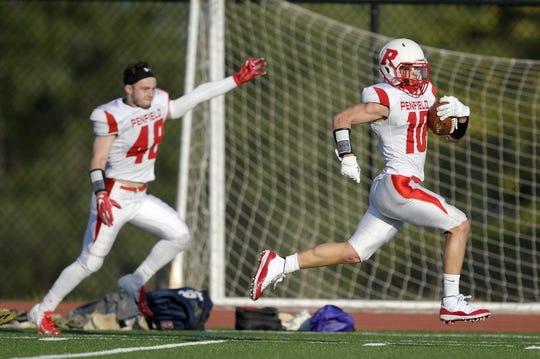 Penfield's Max Hoadley, right, scores a touchdown urged on by teammate Joseph Cocozza during a regular season game played at East High School, Saturday, Sept. 1, 2018.