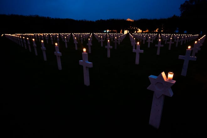 Headstones with lighted candles are pictured at the Meuse-Argonne American Cemetery and Memorial on Nov. 11, 2017, in Romagne-sous-Montfaucon, eastern France, during the Armistice Day commemorations marking the end of WWI.