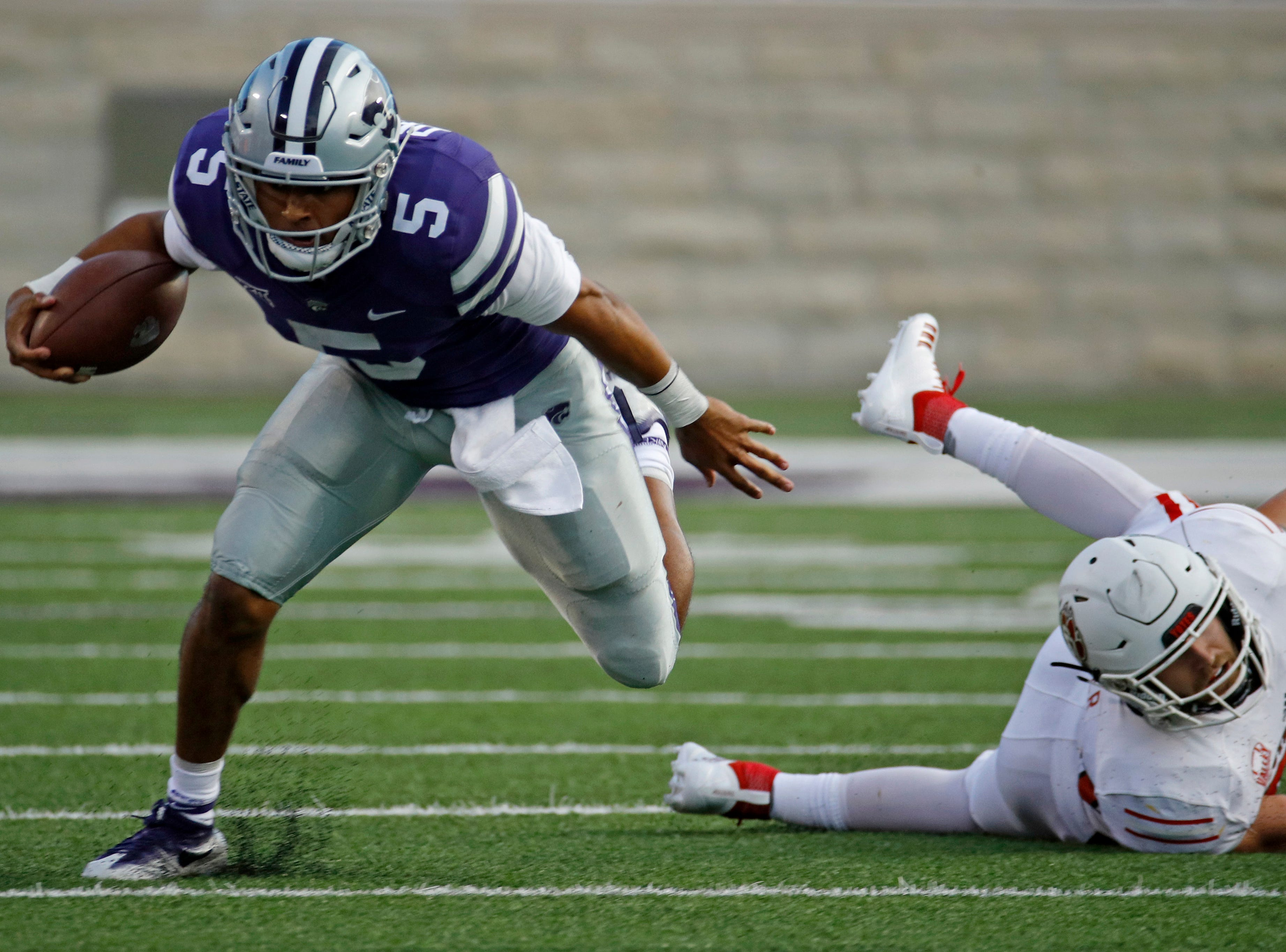 Kansas State quarterback Alex Delton (5) gets past South Dakota linebacker Alex Coker (20) as he runs the ball for a first down during the first half of an NCAA college football game Saturday, Sept. 1, 2018, in Manhattan, Kan. (AP Photo/Charlie Riedel)
